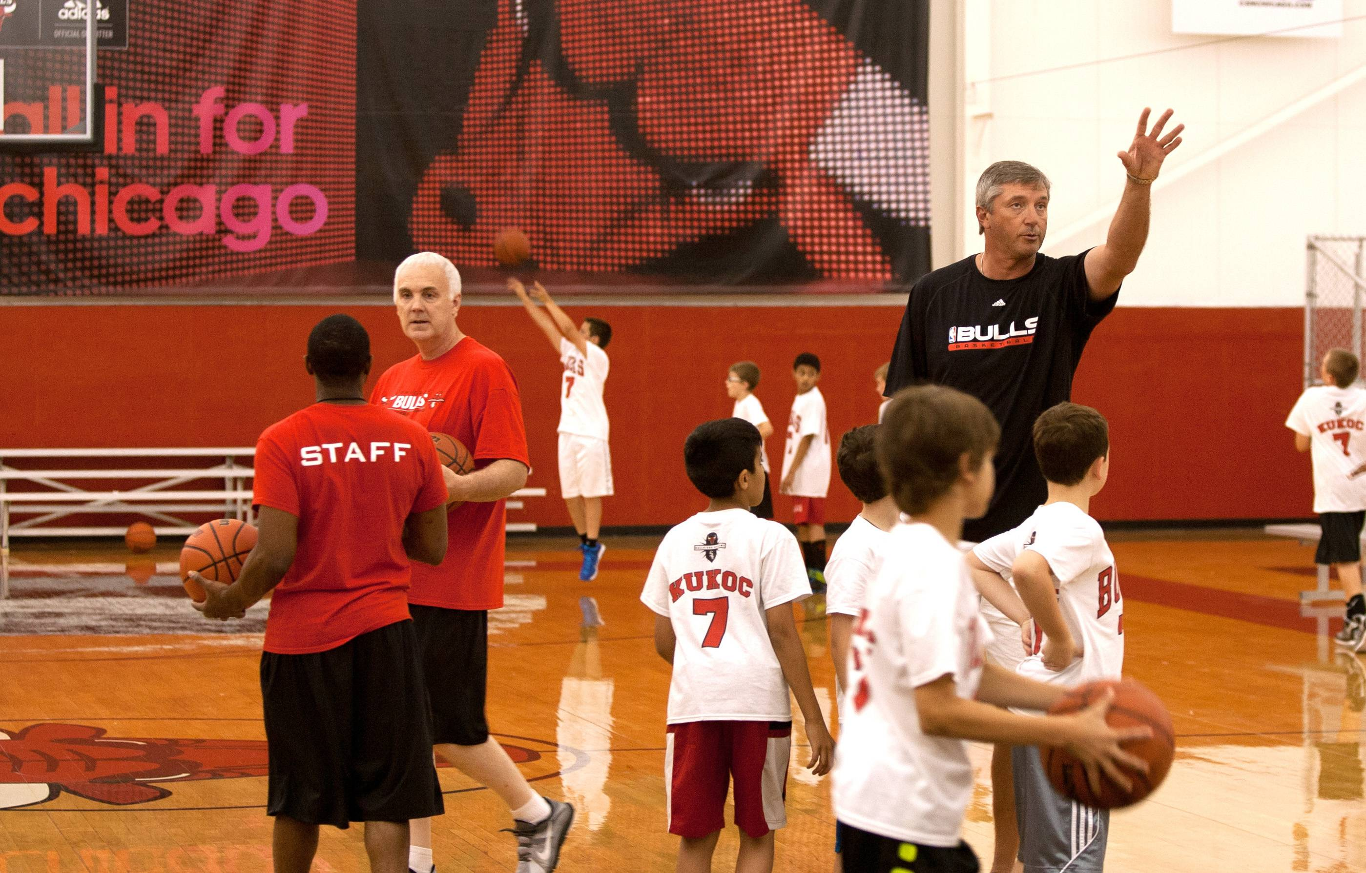 Former Chicago Bulls forward Toni Kukoc talks about shooting during his youth basketball camp at the Bulls/Sox Academy in Lisle.