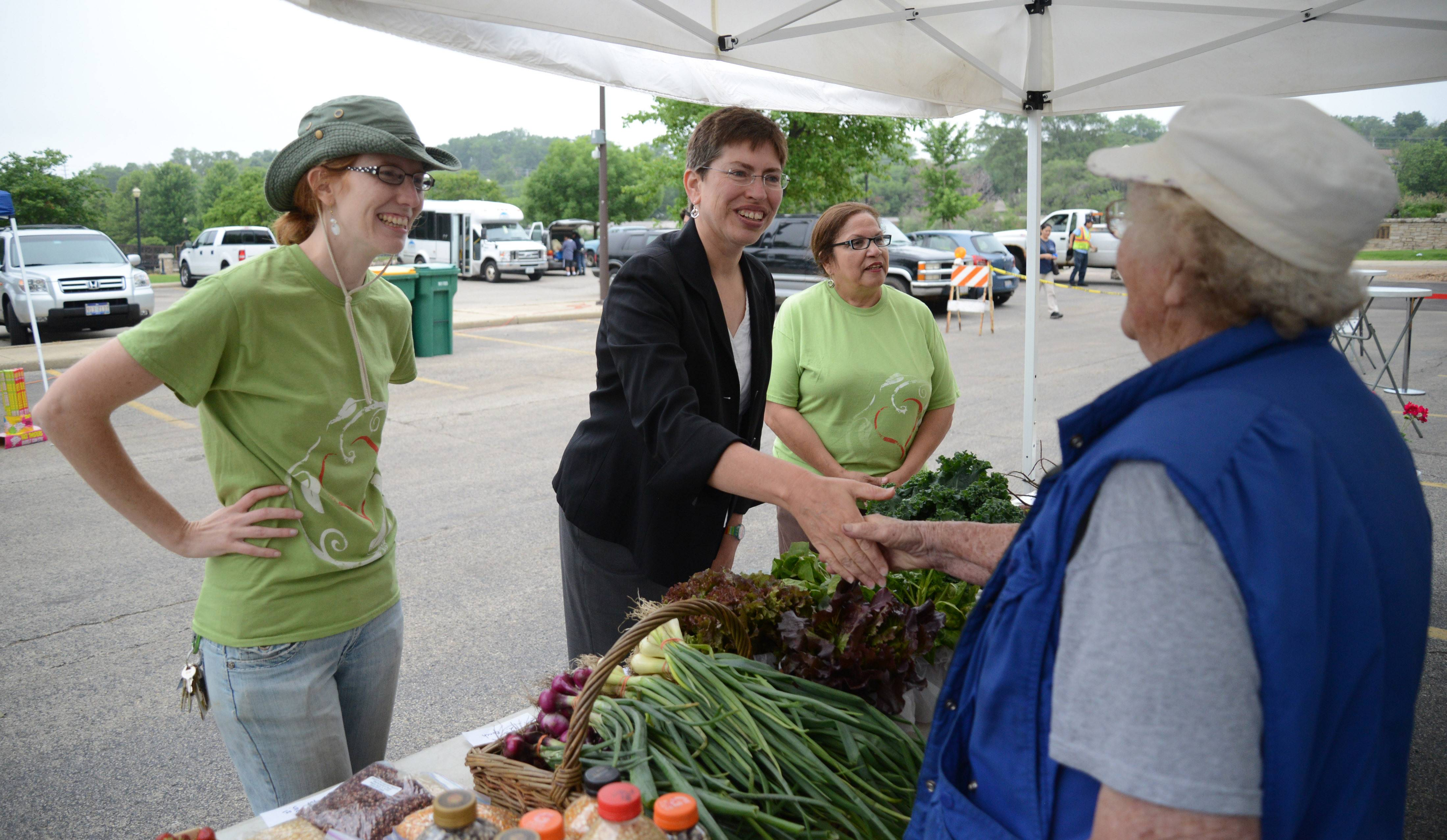 Lt. Gov. Sheila Simon, center, meets Millie Winkelmann of Maple Park and Stojan's Vegetables at the Downtown Elgin Harvest Market Thursday. Simon, escorted by market manager Jennifer Benson, left, chatted with vendors about advocacy for locally grown food and urging more markets to accept Link cards so all residents can access homegrown products.