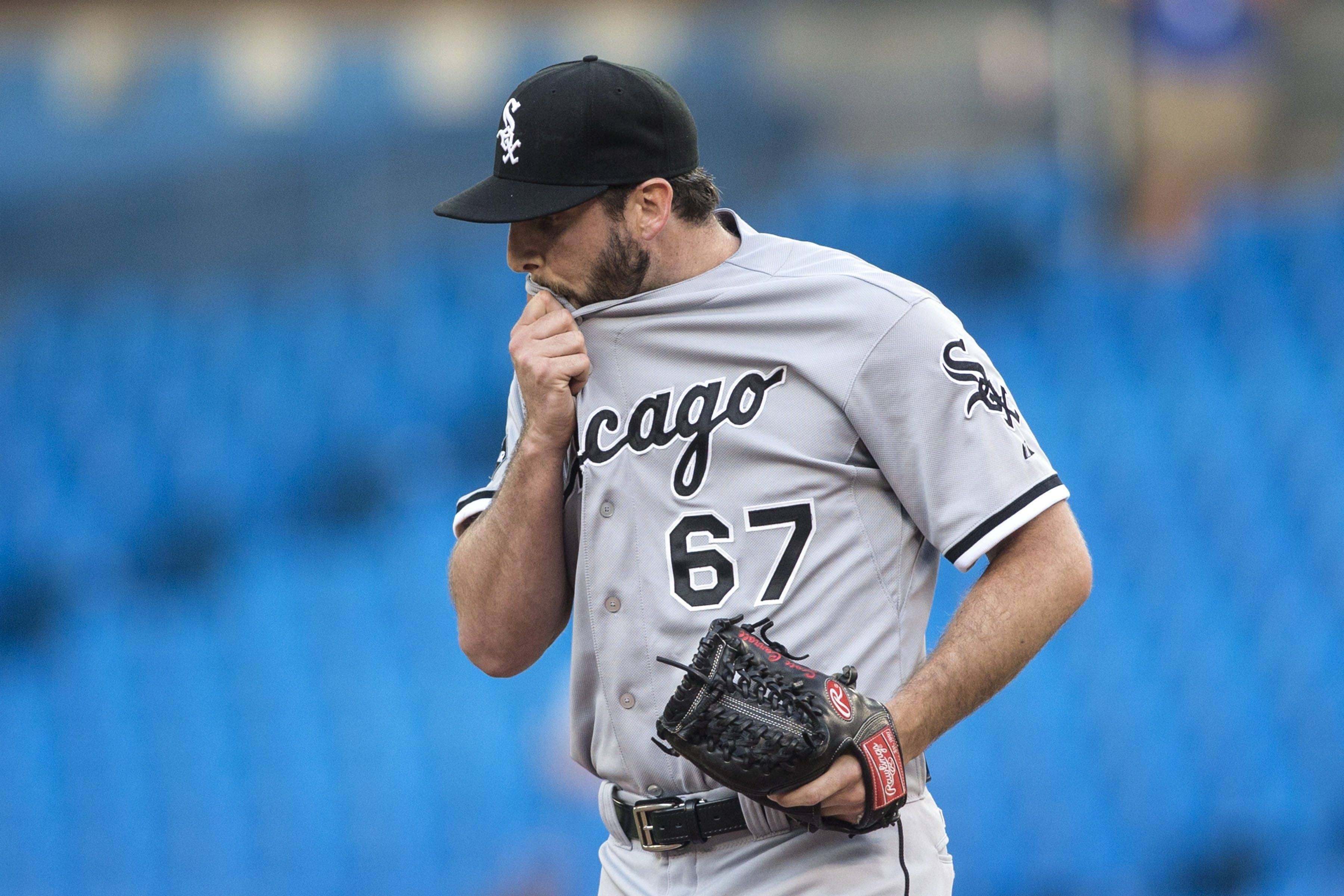 Chicago White Sox starting pitcher Scott Carroll reacts as he works against Toronto Blue Jays during first inning american league baseball action in Toronto on Thursday June 26 , 2014. (AP Photo/The Canadian Press, Chris Young)