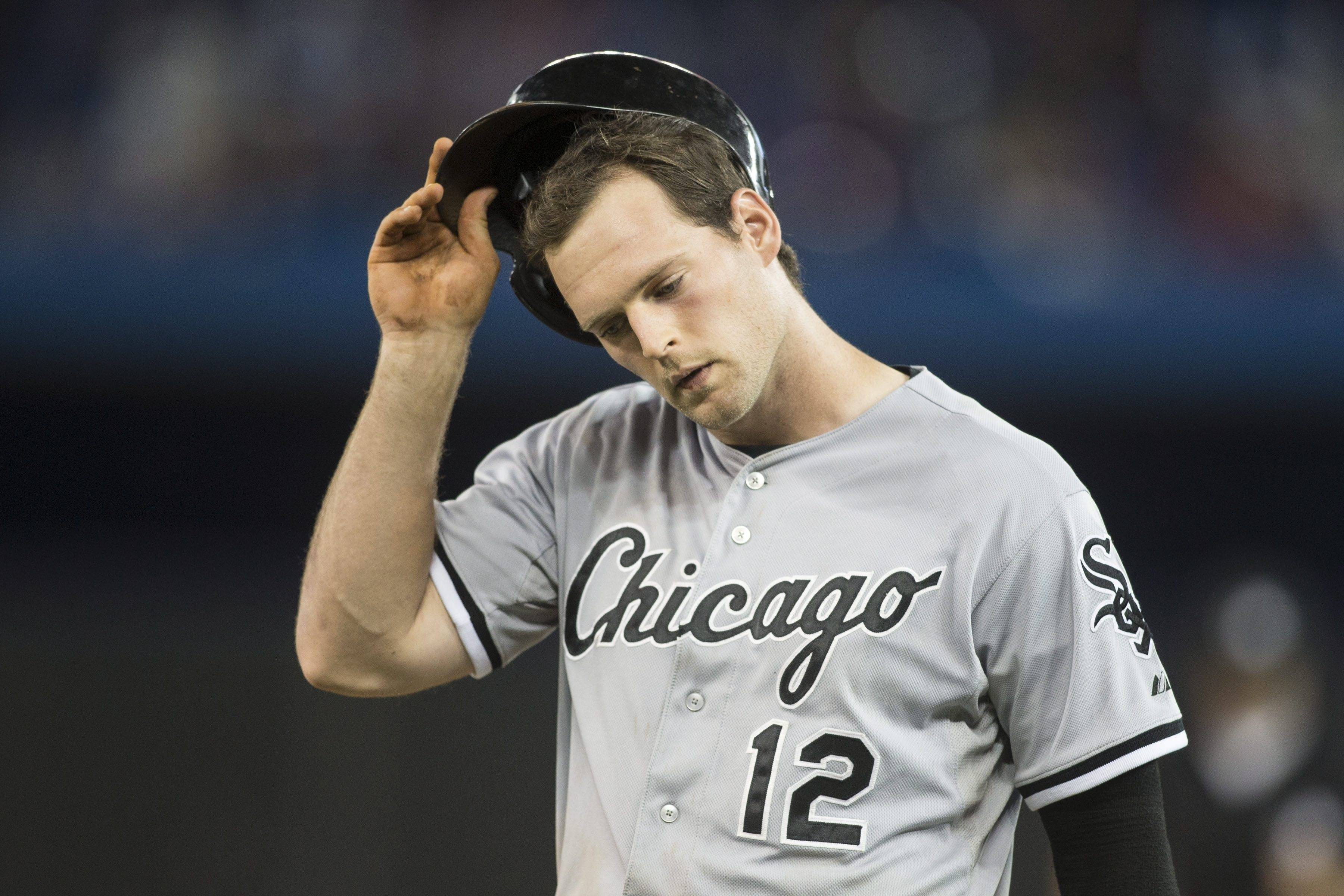 White Sox' Conor Gillaspie removes his helmet after grounding out to first in the ninth inning to complete his team's 0-7 loss to Toronto Blue Jays in baseball action in Toronto Thursday.