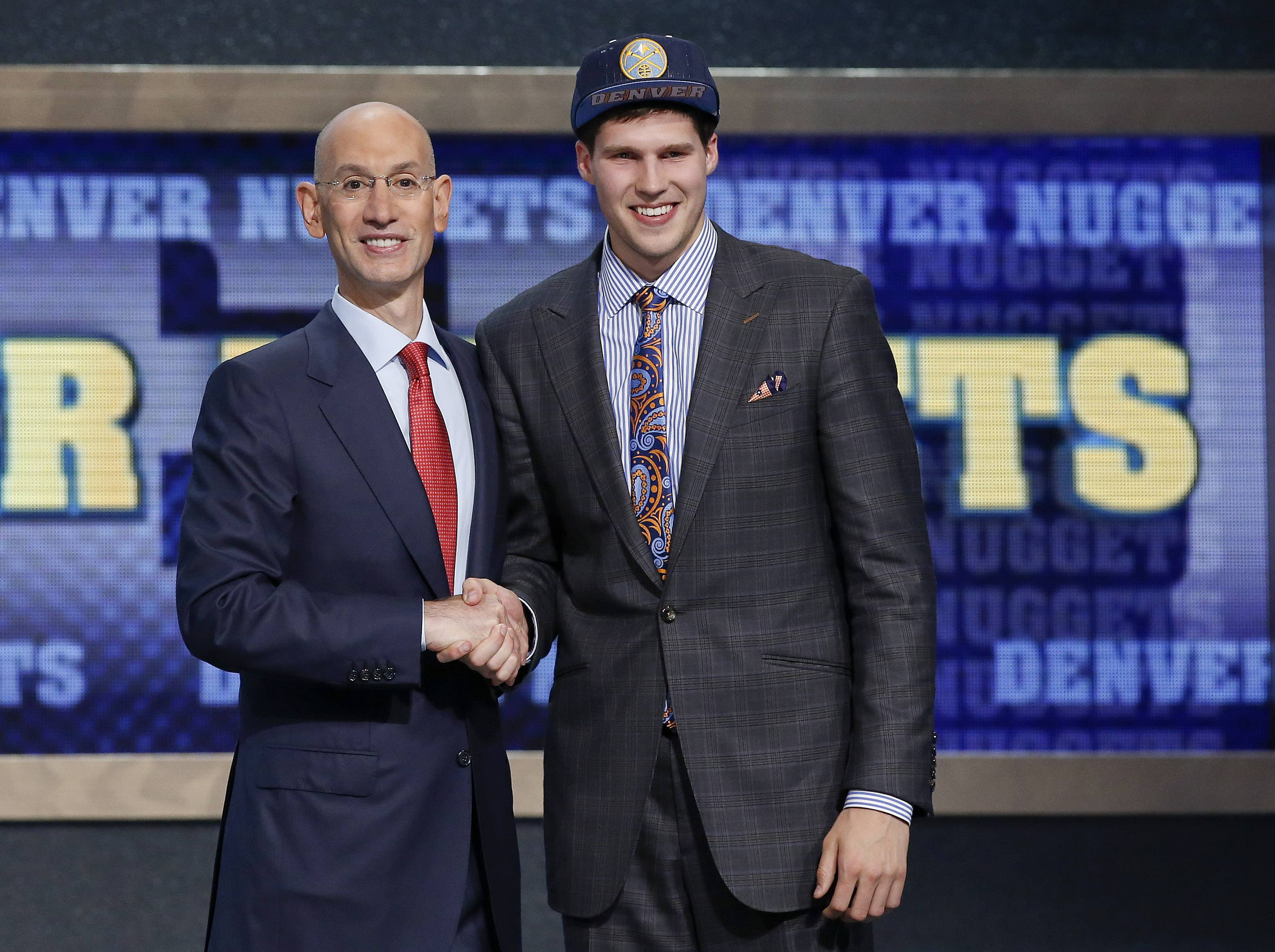 Creighton's Doug McDermott, right, poses for a photo with NBA Commissioner Adam Silver after being selected 11th overall by the Denver Nuggets during the 2014 NBA draft, Thursday, June 26, 2014, in New York. (AP Photo/Kathy Willens)