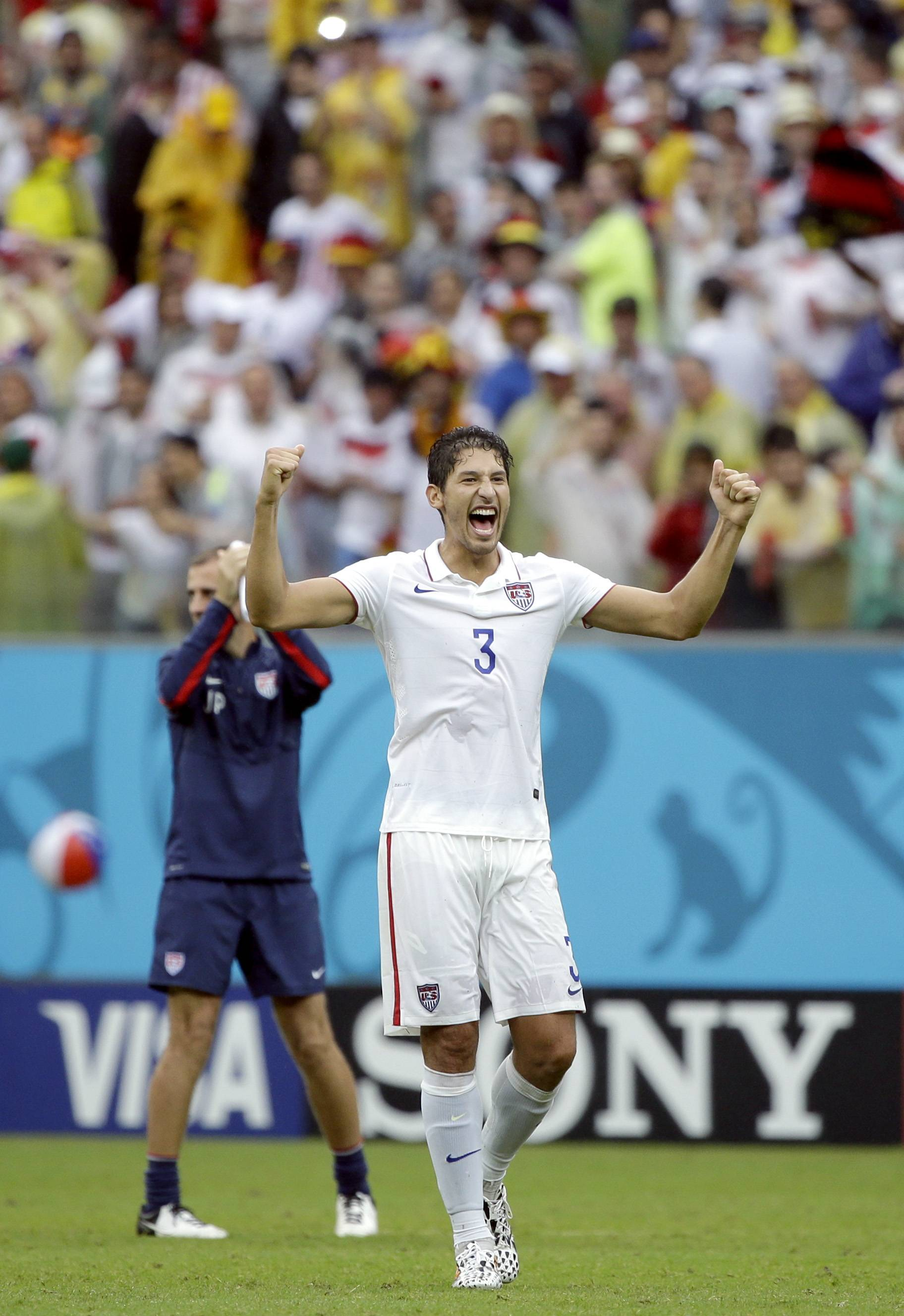 United States defender Omar Gonzalez celebrates after qualifying for the next World Cup round following their 1-0 loss to Germany.