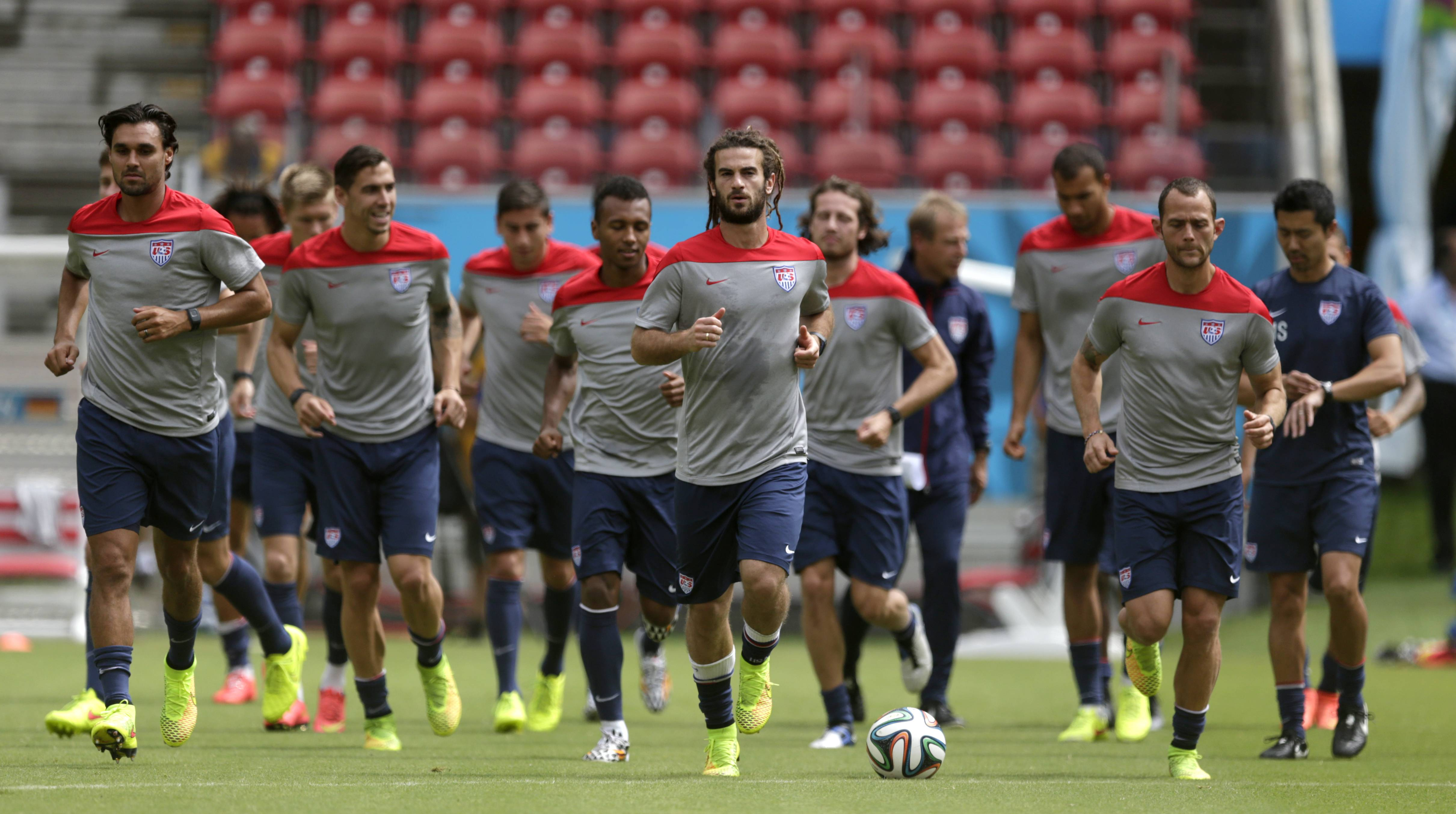 United States' Kyle Beckerman, center, jogs with teammates during a training session in Recife, Brazil, Wednesday, June 25, 2014. The United States will play Germany in group G of the 2014 soccer World Cup on June 26.