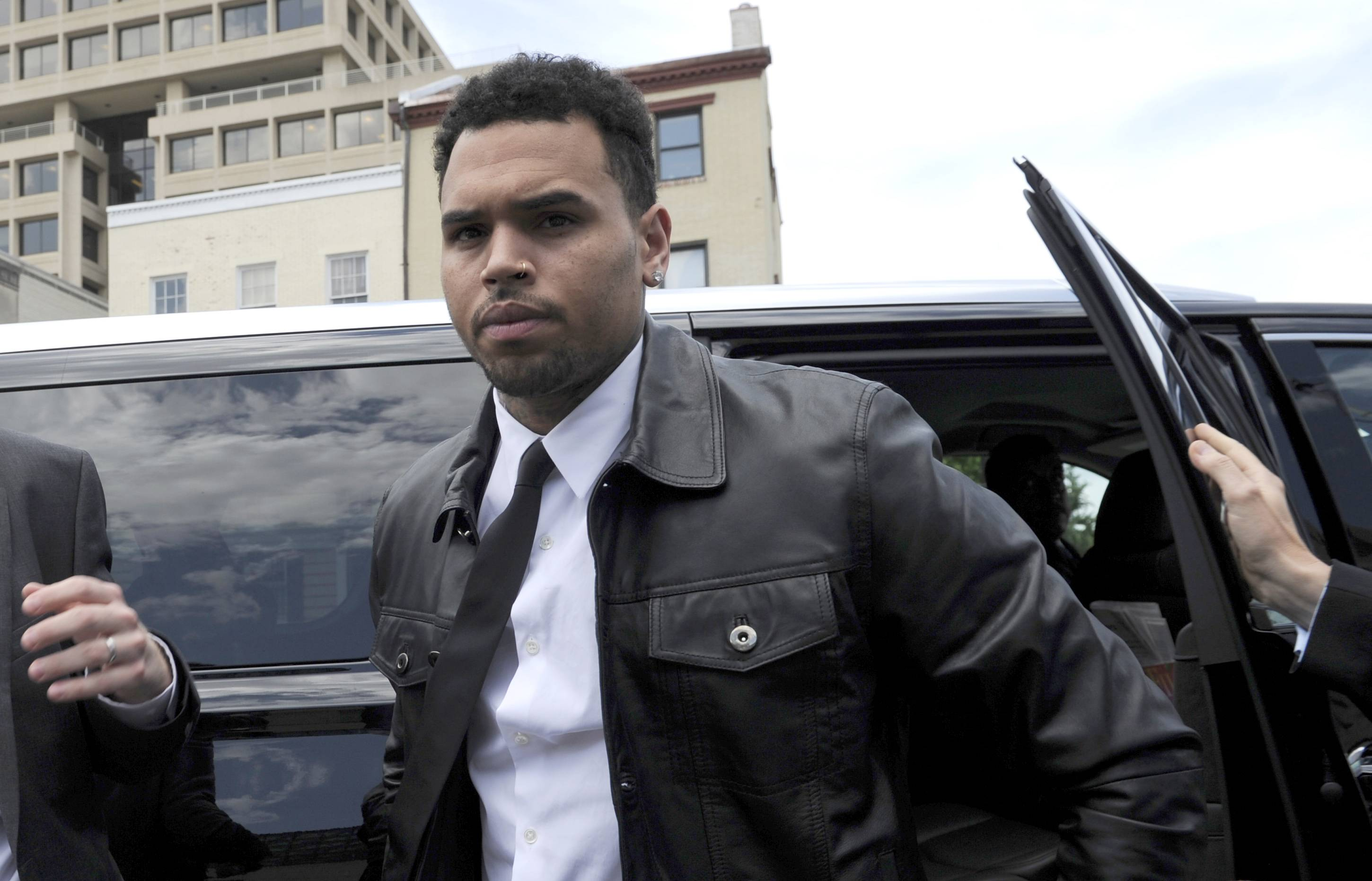 Singer Chris Brown arrives at the D.C. Superior Court in Washington Wednesday for a hearing on the assault charge he faces.