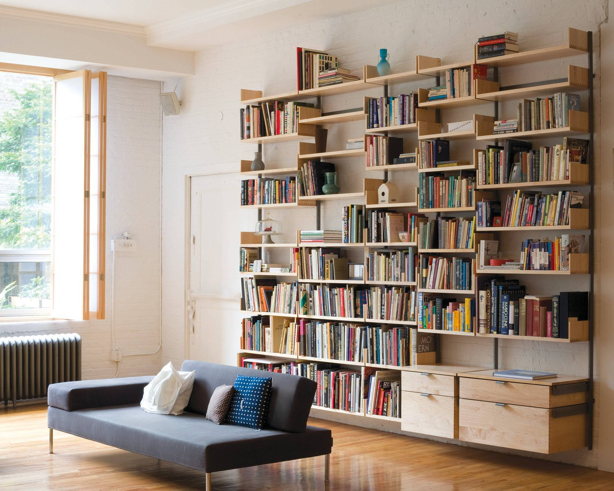 If custom built-ins aren't in the cards for displaying your books, try a modular, expandable system such as Atlas Industries' AS4.