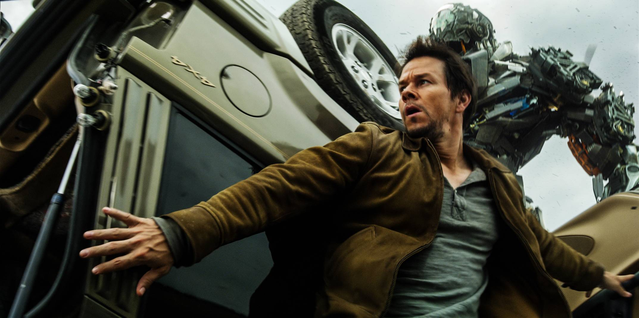 "Cade Yeager (Mark Wahlberg) tries to survive another robotic attack in Michael Bay's ""Transformers: Age of Extinction."""