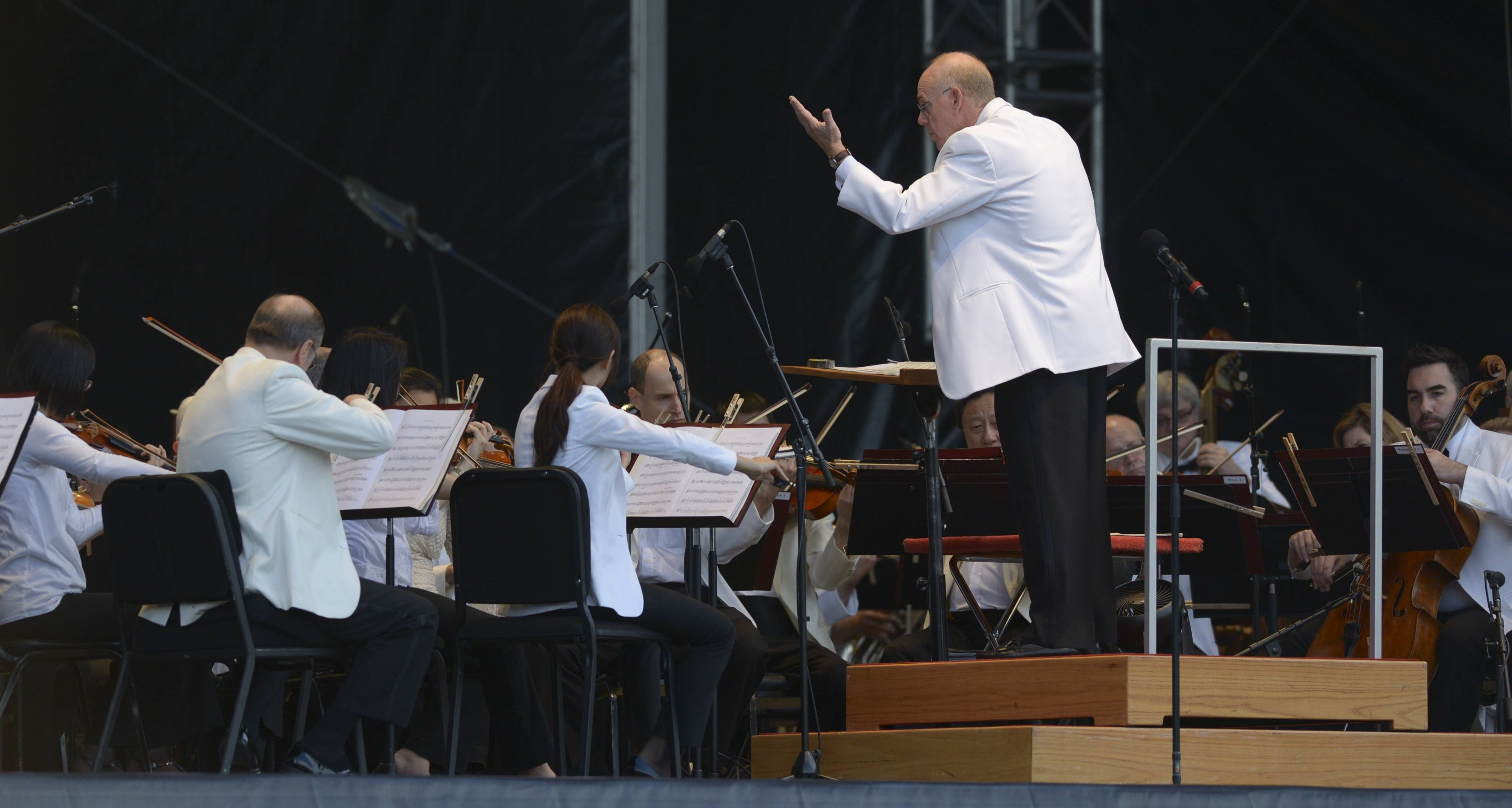 Conductor Richard Kaufaman leads the Chicago Symphony Orchestra as they perform the first of three nights at The Morton Arboretum in Lisle.