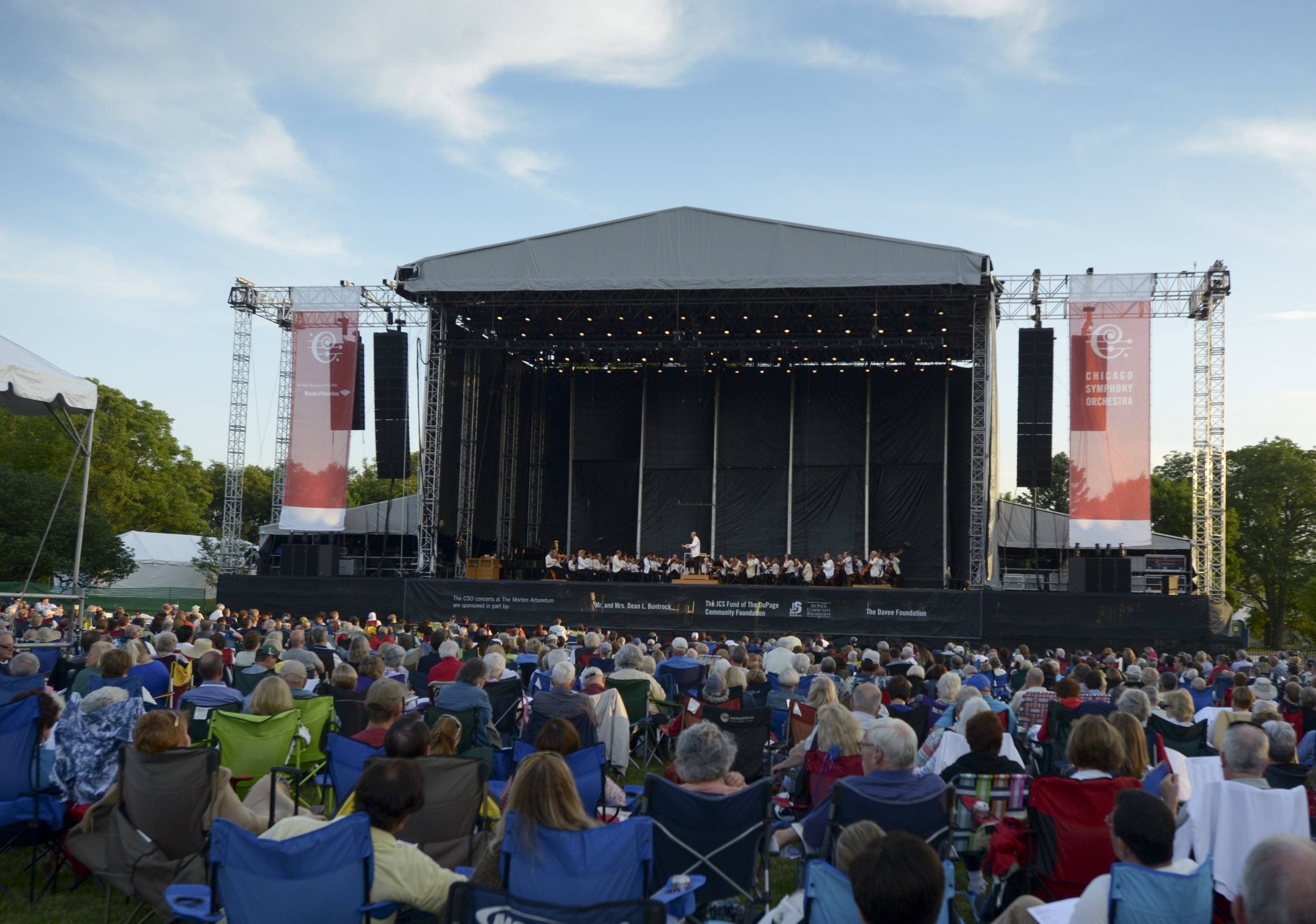 Conductor Richard Kaufaman leads the Chicago Symphony Orchestra, in front of a full house, as they perform the first of three nights at The Morton Arboretum in Lisle.