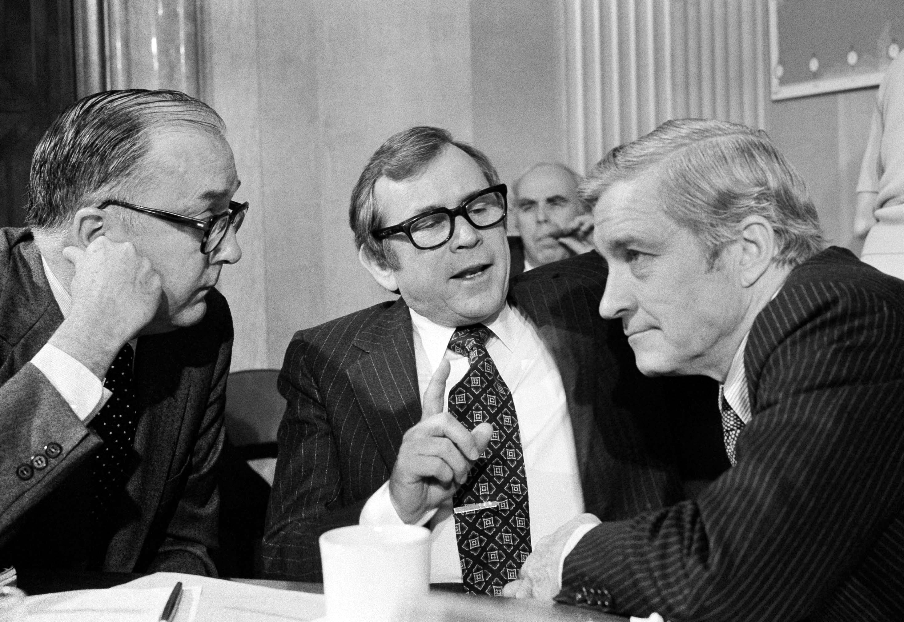 Senate Foreign Relations Committee members, from left, Sen. Jesse Helms, a North Carolina Republican, Sen. Howard Baker, a Tennessee Republican, and Sen. Charles Percy, an Illinois Republican, discuss a vote on the SALT II treaty Nov. 9, 1979.