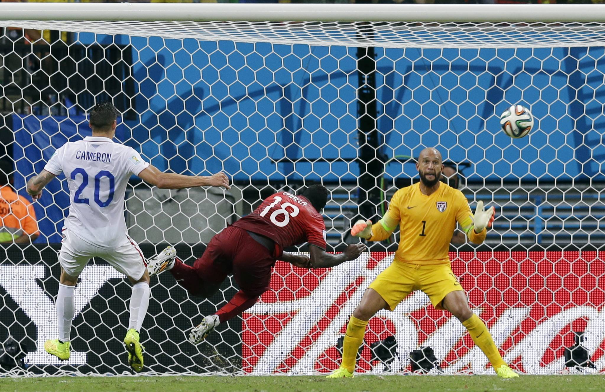 Portugal's Silvestre Varela heads the ball past U.S. goalkeeper Tim Howard on Sunday to leave the match in a 2-2 draw at the World Cup in Manaus, Brazil.