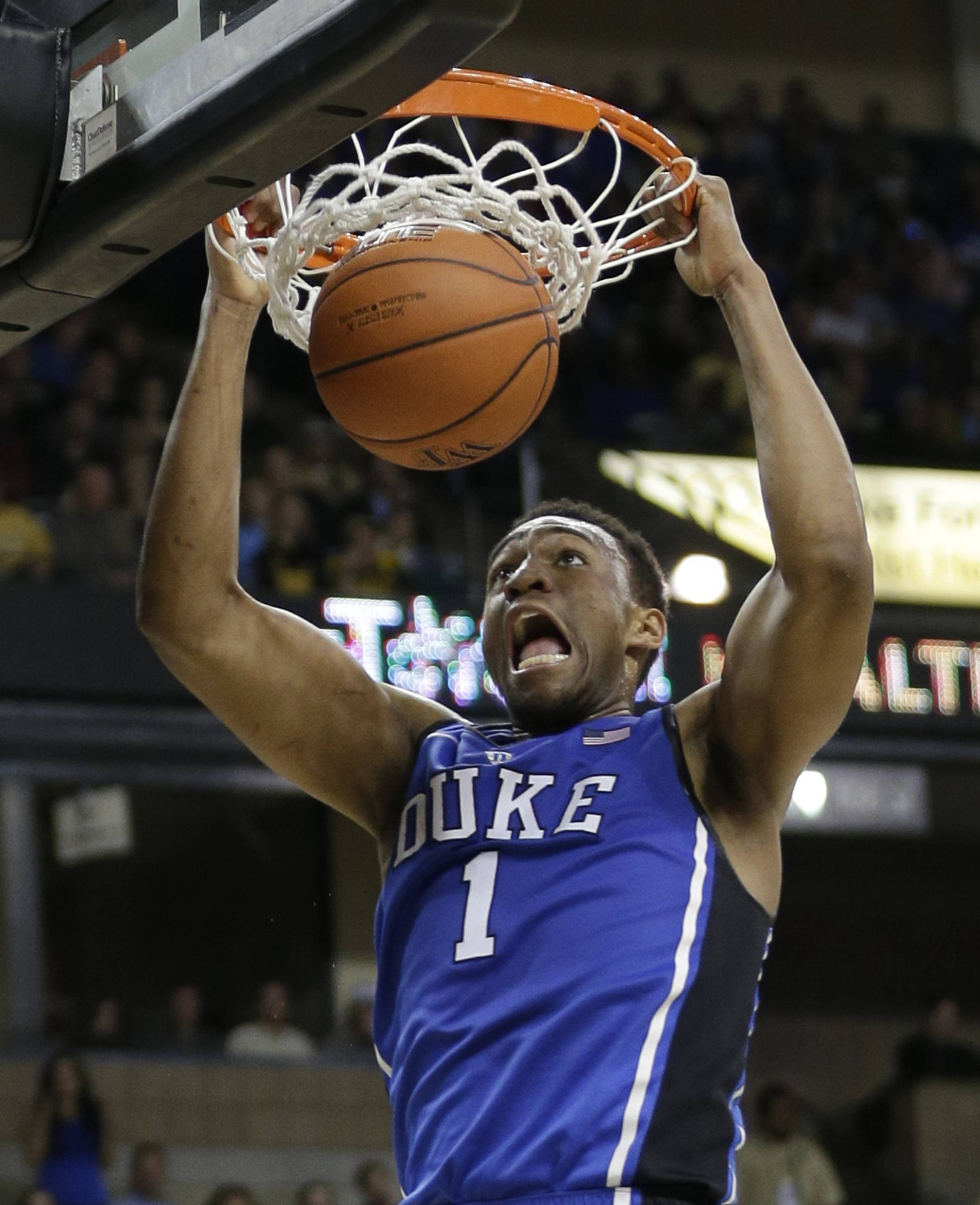 FILE - In this March 5, 2014 film photo, Duke's Jabari Parker (1)  dunks against Wake Forest during the second half of an NCAA college basketball game in Winston-Salem, N.C. Parker is a possible pick in the 2014 NBA Draft, Thursday, June 26, 2014 in New York.