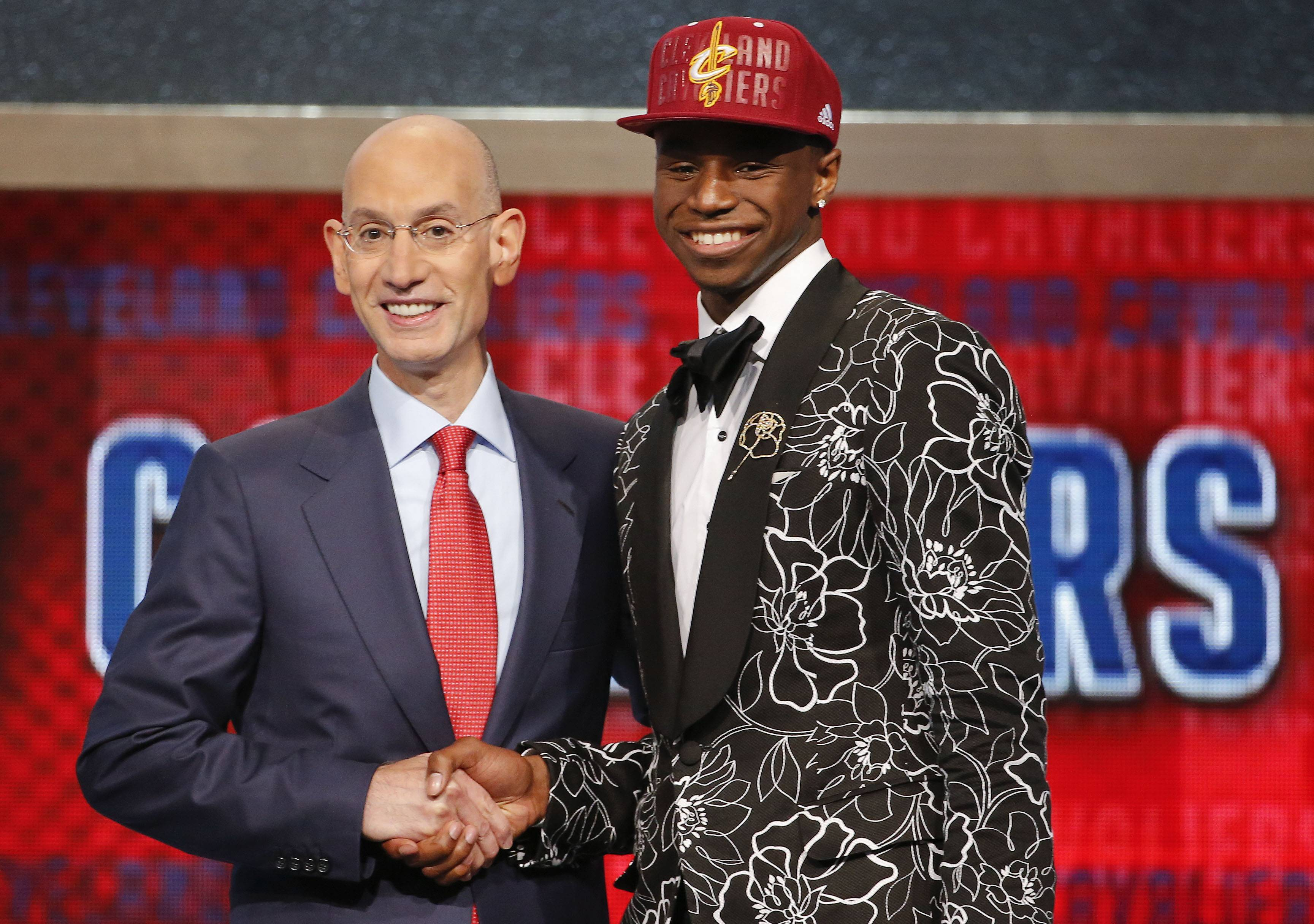 NBA Commissioner Adam Silver, left, congratulates Andrew Wiggins of Kansas who was selected by the Cleveland Cavaliers as the number one pick in the 2014 NBA draft, Thursday, June 26, 2014, in New York.