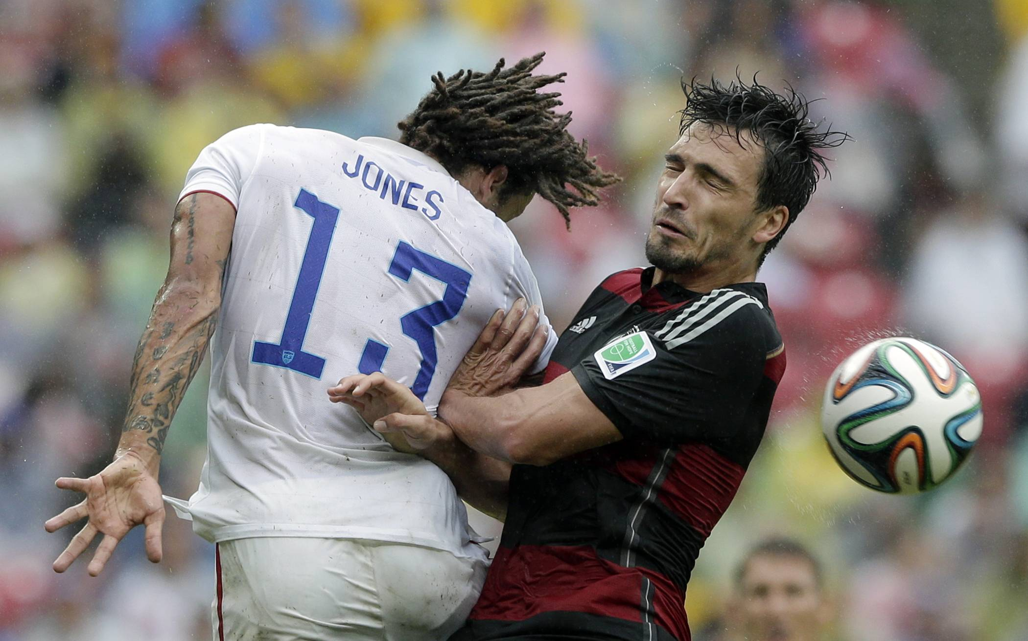 Germany's Mats Hummels, right, and United States' Jermaine Jones go for a header during the group G World Cup soccer match between the USA and Germany at the Arena Pernambuco in Recife, Brazil, Thursday, June 26, 2014.