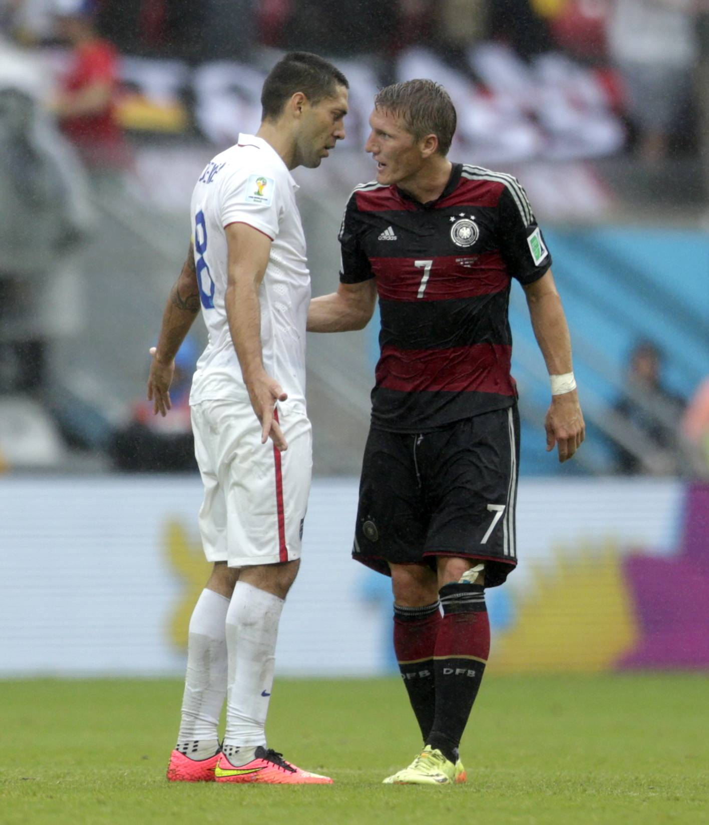 United States' Clint Dempsey argues with Germany's Bastian Schweinsteiger at the half during the group G World Cup soccer match between the United States and Germany at the Arena Pernambuco in Recife, Brazil, Thursday, June 26, 2014.