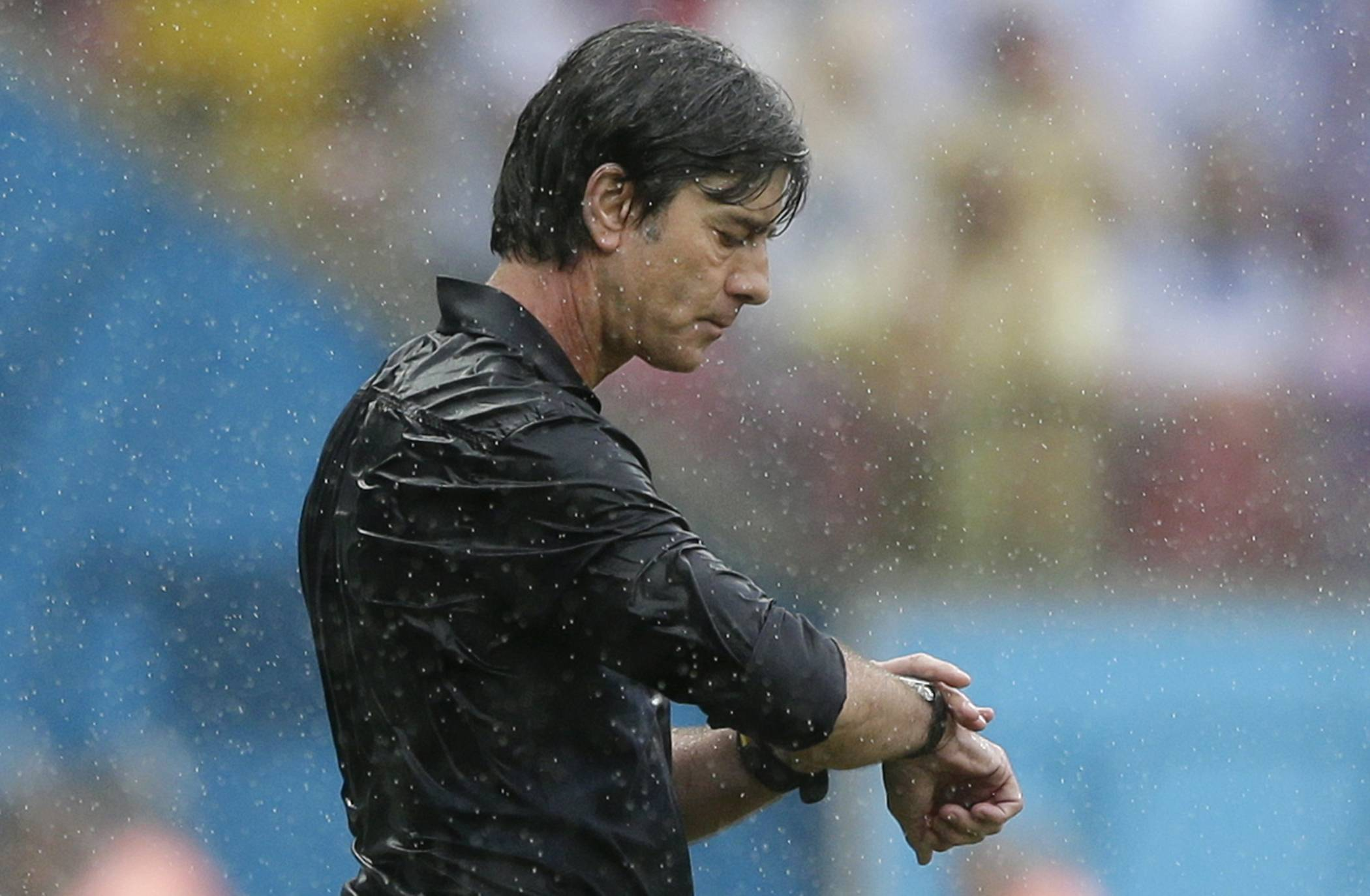 Germany's head coach Joachim Loew checks his watch during the group G World Cup soccer match between the USA and Germany at the Arena Pernambuco in Recife, Brazil, Thursday, June 26, 2014.