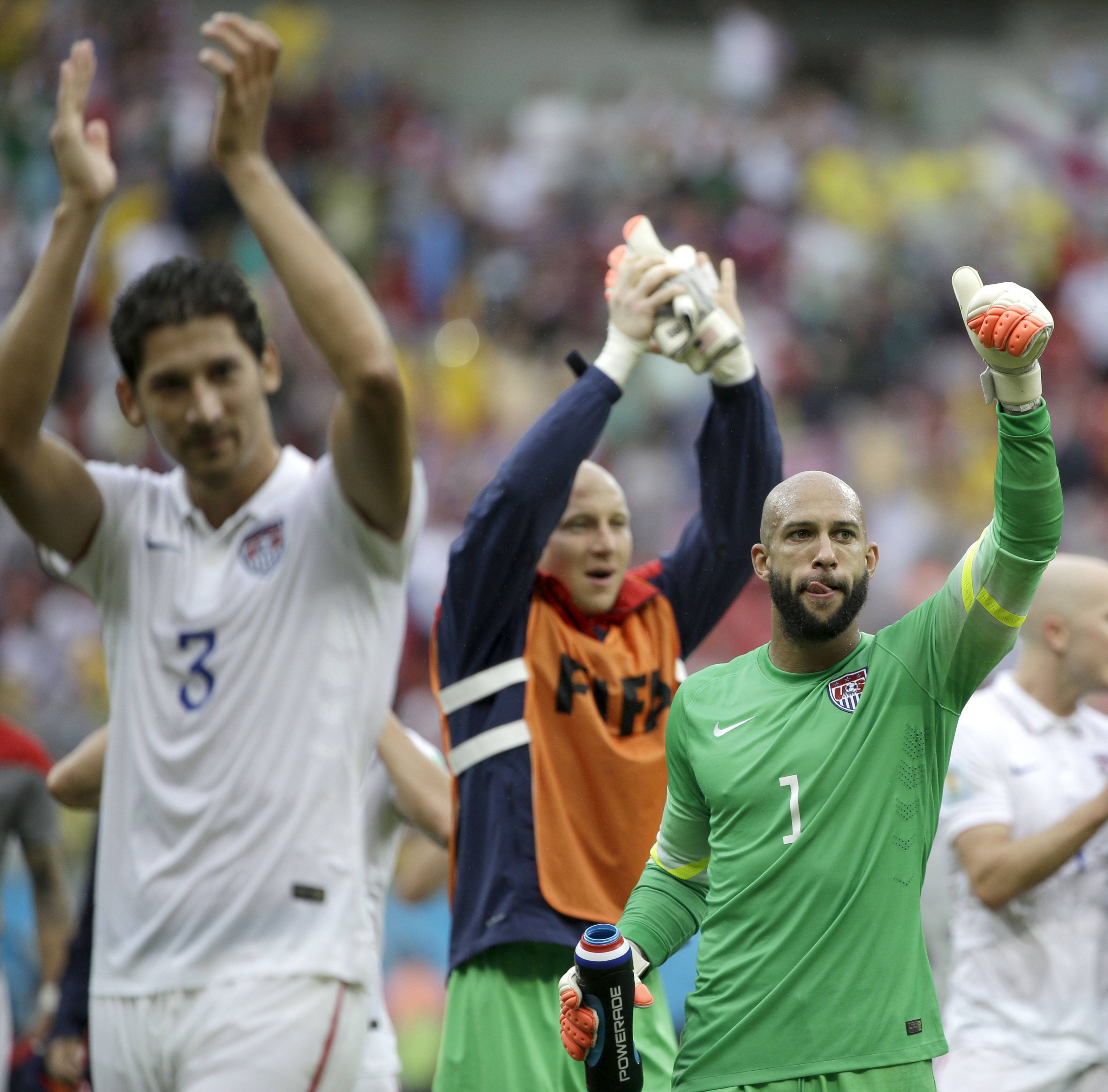 United States' goalkeeper Tim Howard (1) and his teammates celebrate after qualifying for the next World Cup round following their 1-0 loss to Germany during the group G World Cup soccer match between the USA and Germany at the Arena Pernambuco in Recife, Brazil, Thursday, June 26, 2014.