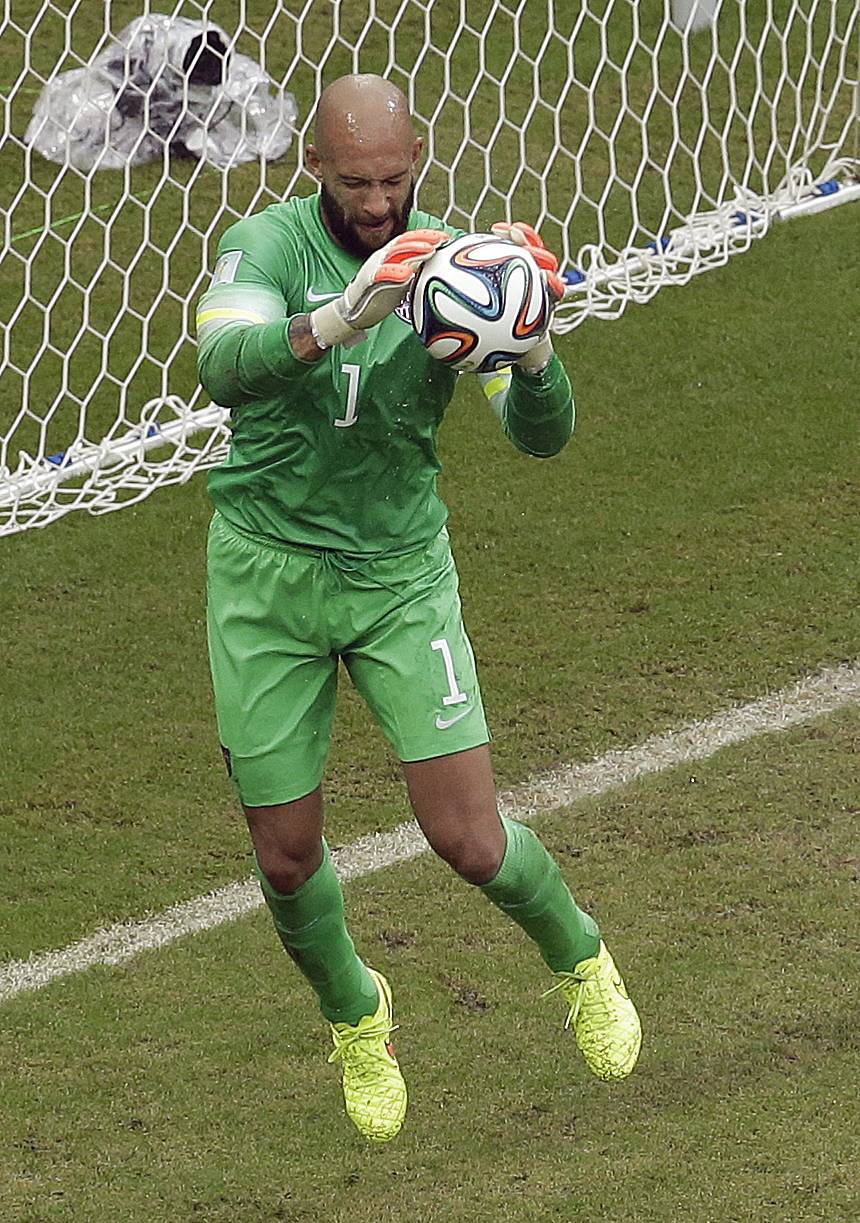 United States' goalkeeper Tim Howard makes a save during the group G World Cup soccer match between the USA and Germany at the Arena Pernambuco in Recife, Brazil, Thursday, June 26, 2014.