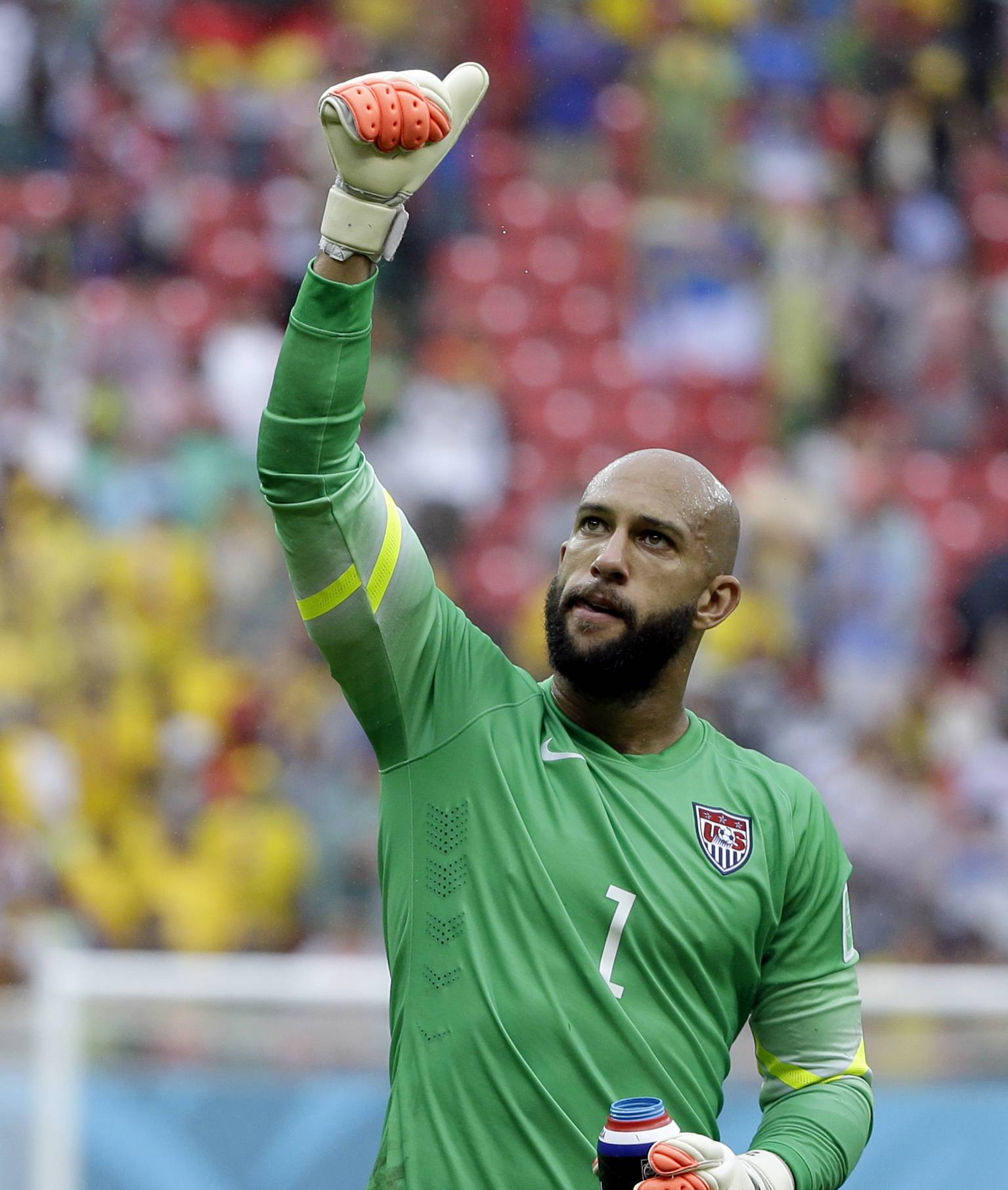 United States' goalkeeper Tim Howard gives a thumbs-up to supporters after qualifying for the next World Cup round following their 1-0 loss to Germany during the group G World Cup soccer match between the USA and Germany at the Arena Pernambuco in Recife, Brazil, Thursday, June 26, 2014.