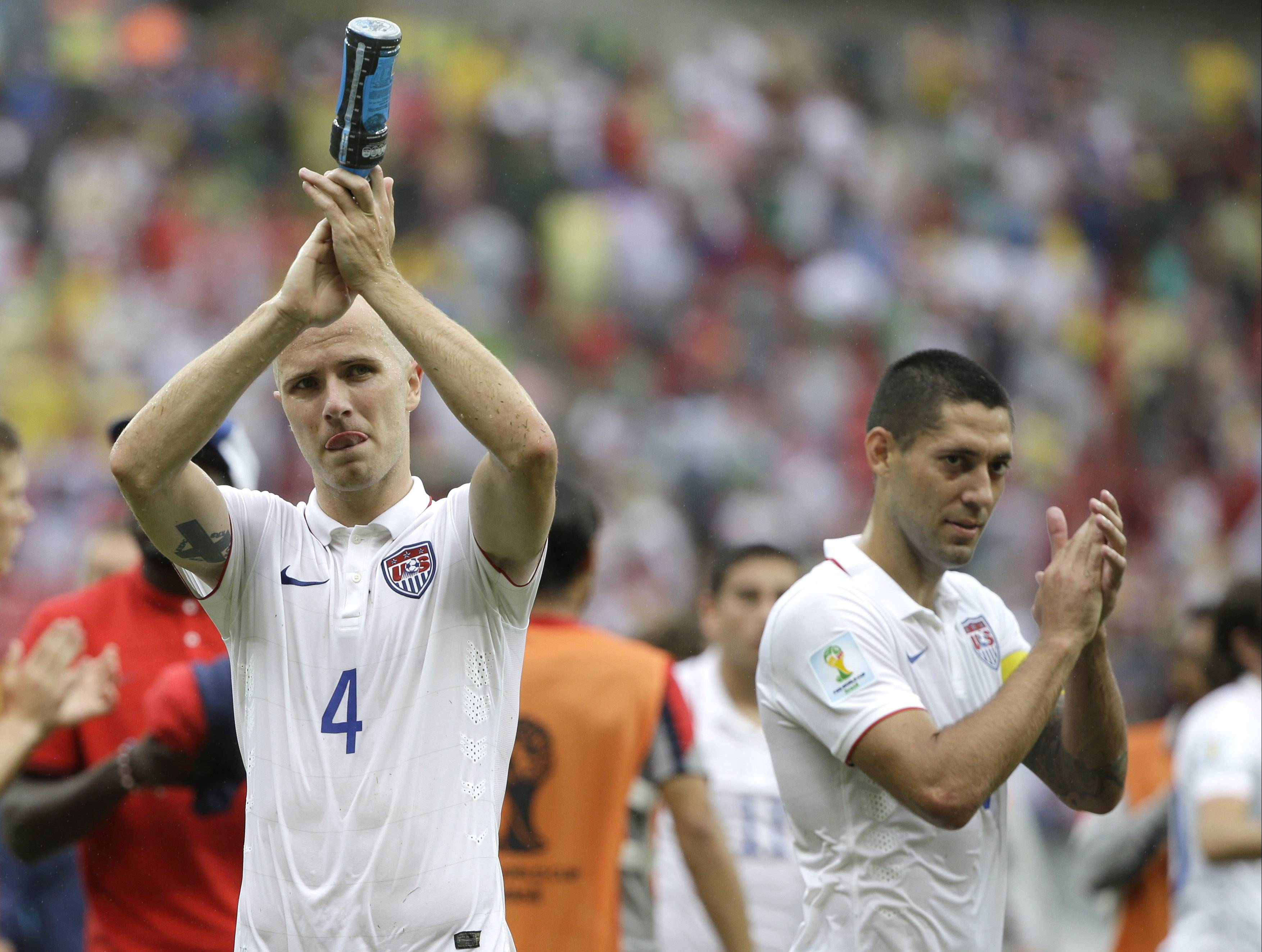 United States' Michael Bradley, left, and Clint Dempsey applaud after qualifying for the next World Cup round following their 1-0 loss to Germany during the group G World Cup soccer match between the USA and Germany at the Arena Pernambuco in Recife, Brazil, Thursday, June 26, 2014.