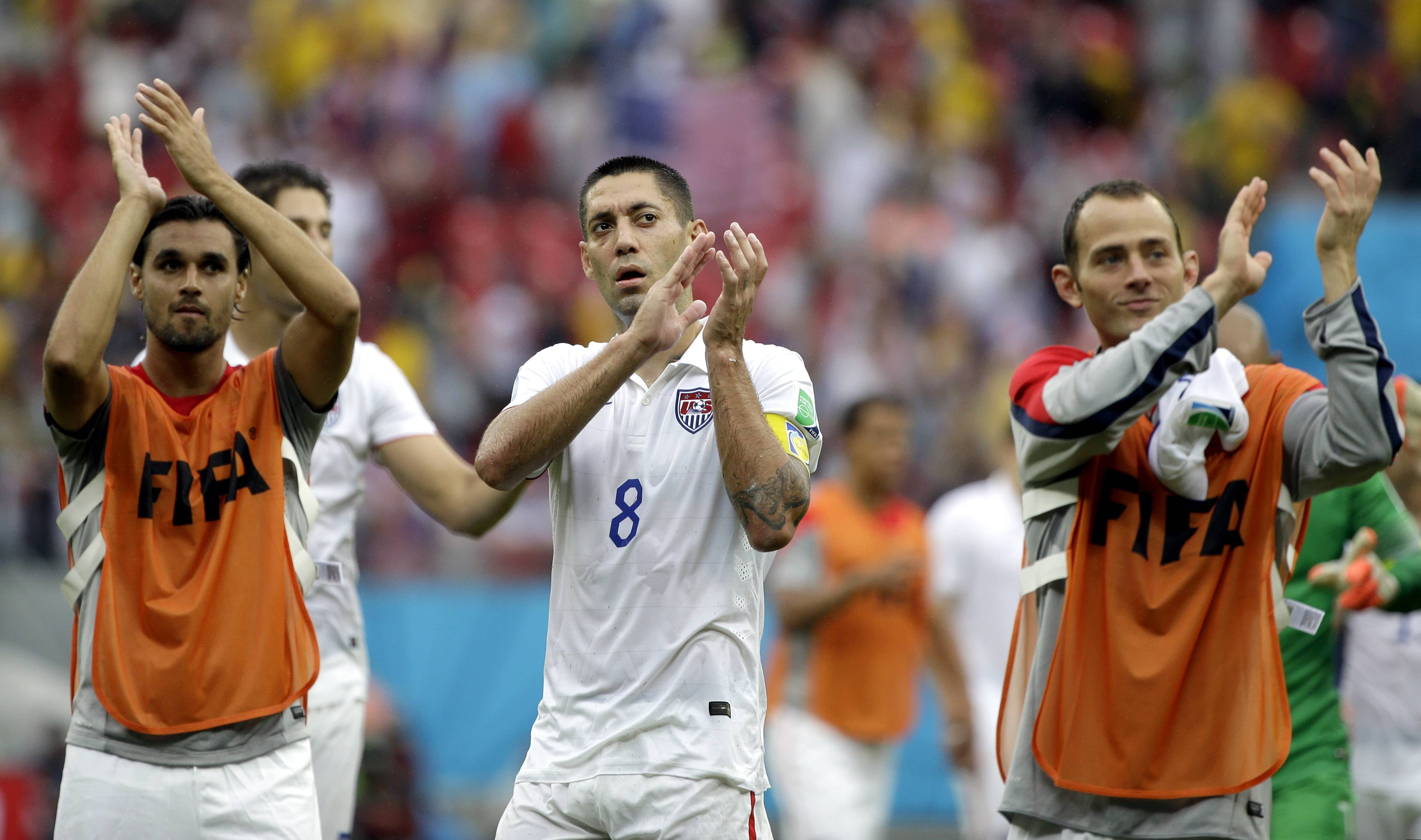 United States' Clint Dempsey, center, and his teammates applaud after qualifying for the next World Cup round following their 1-0 loss to Germany during the group G World Cup soccer match between the USA and Germany at the Arena Pernambuco in Recife, Brazil, Thursday, June 26, 2014.