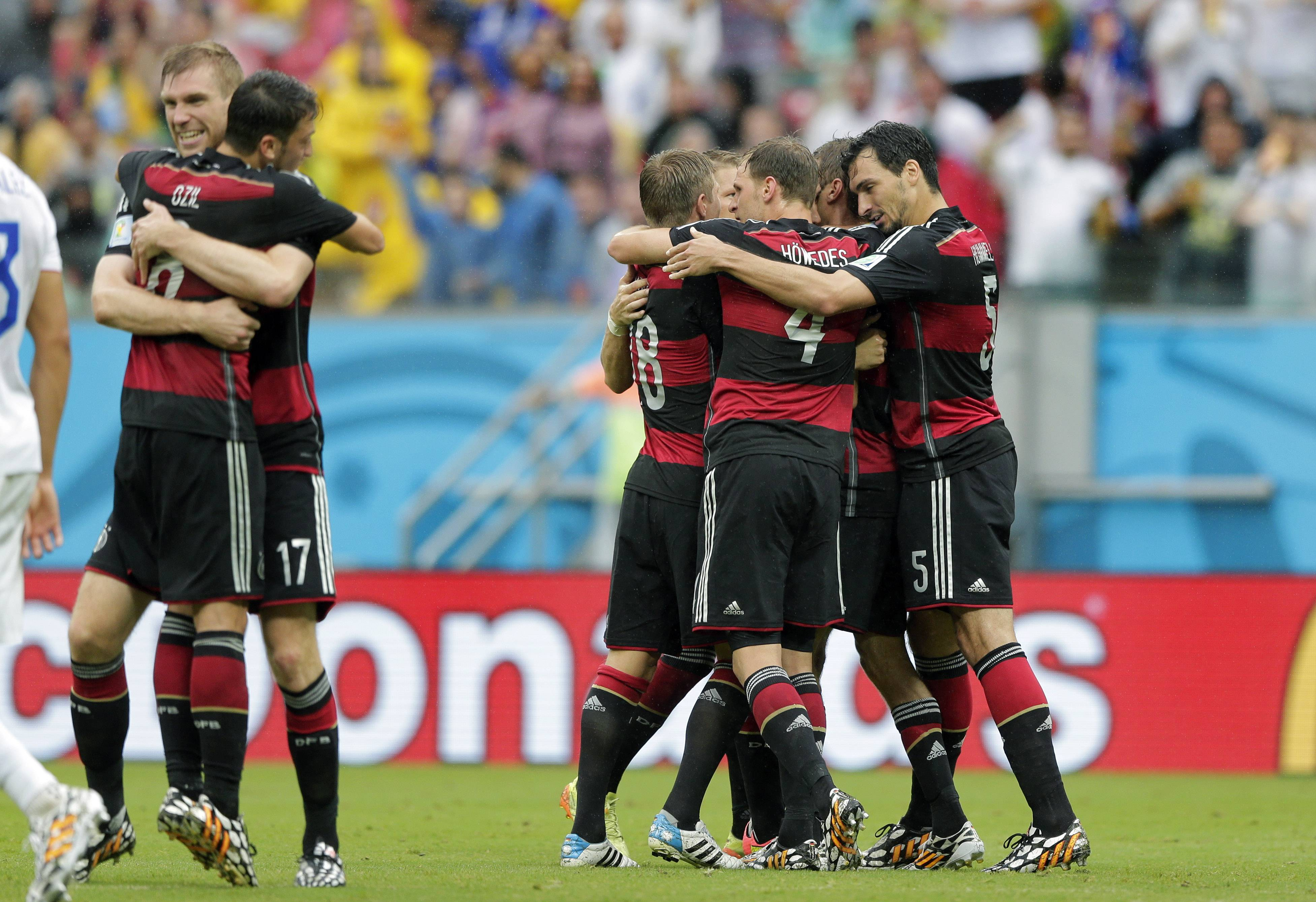 Germany players celebrate after scoring the opening goal during the group G World Cup soccer match between the USA and Germany at the Arena Pernambuco in Recife, Brazil, Thursday, June 26, 2014.