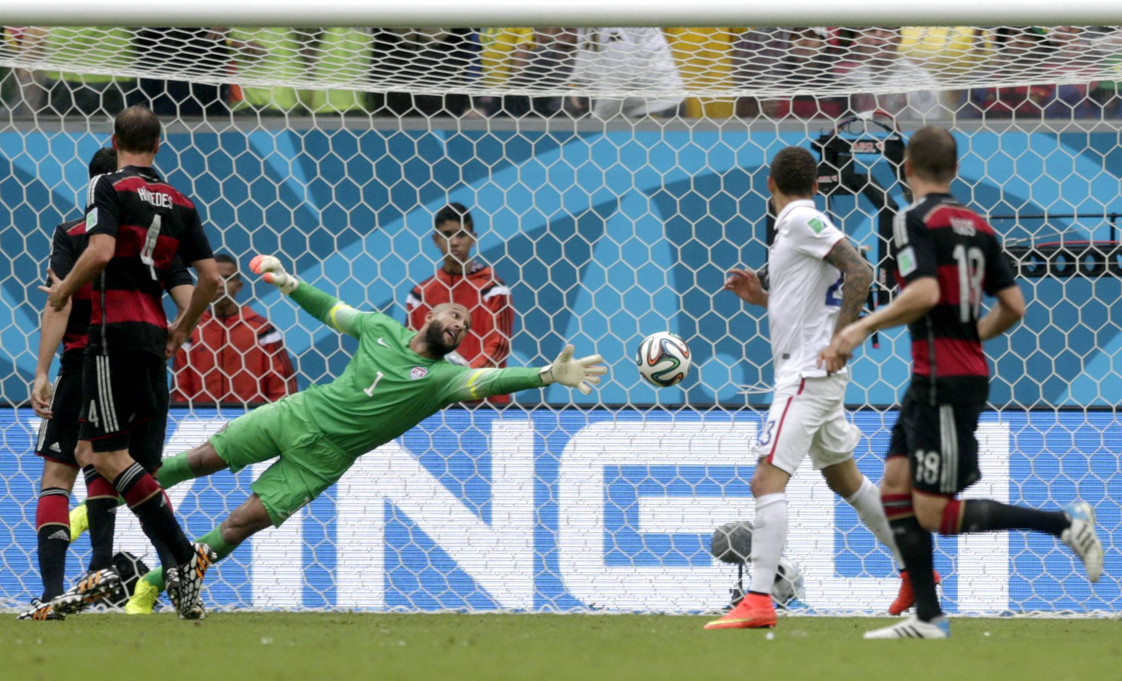 United States' goalkeeper Tim Howard can not stop a shot by Germany's Thomas Mueller to score his side's first goal during the group G World Cup soccer match between the United States and Germany at the Arena Pernambuco in Recife, Brazil, Thursday, June 26, 2014.