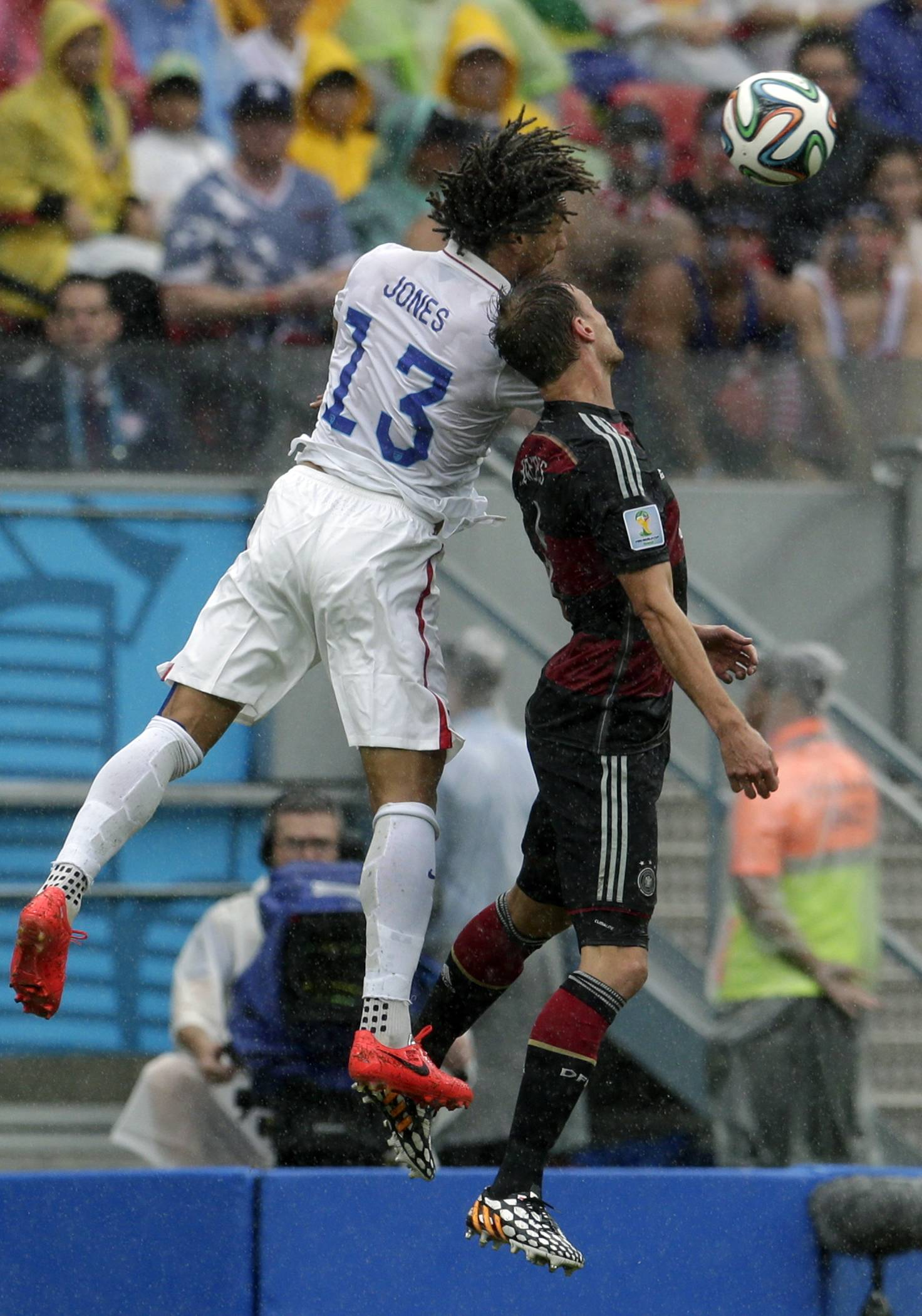 United States' Jermaine Jones, left, and Germany's Benedikt Hoewedes go for a header during the group G World Cup soccer match between the USA and Germany at the Arena Pernambuco in Recife, Brazil, Thursday, June 26, 2014.