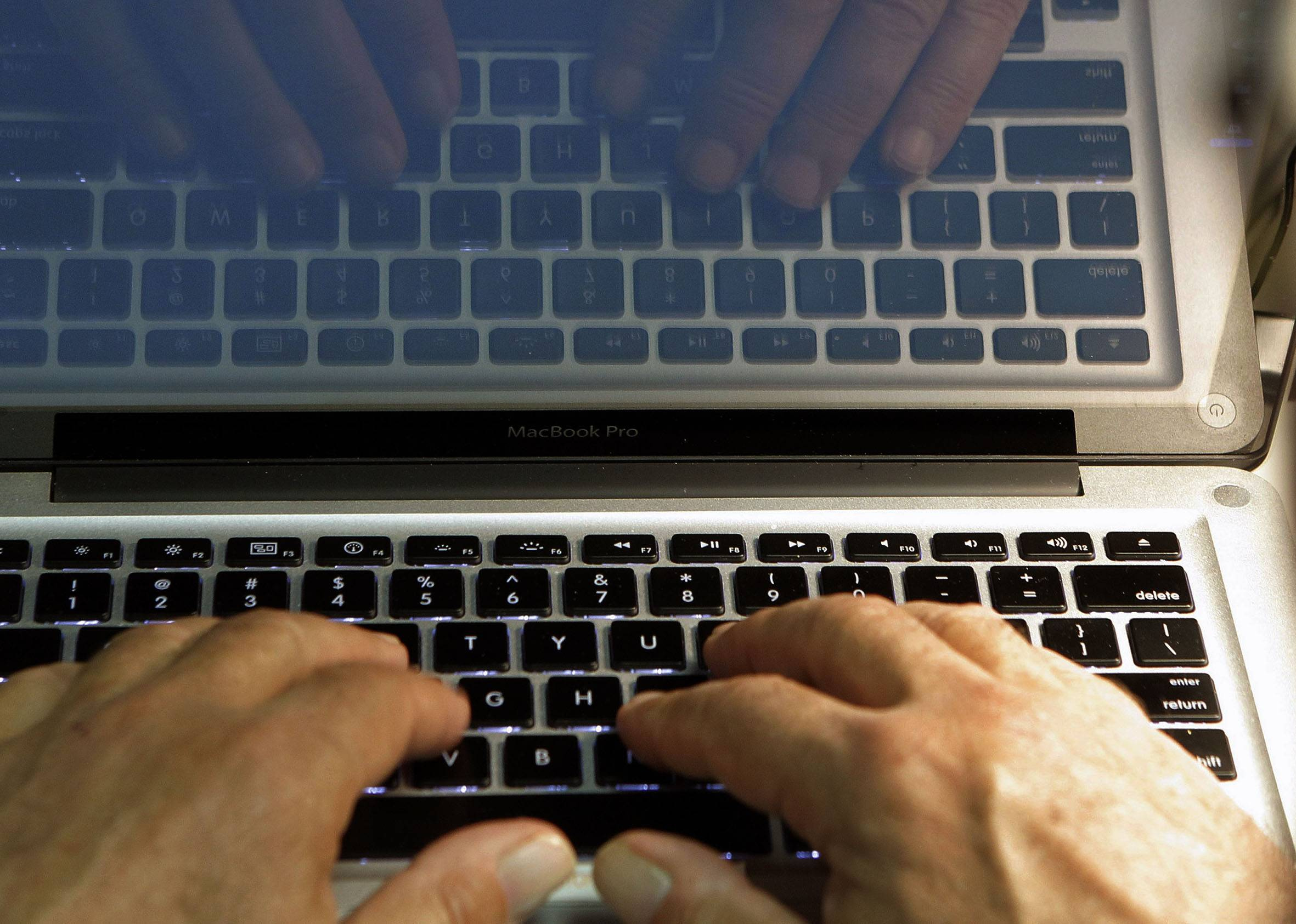 "In this Feb. 27, 2013 photo illustration, hands type on a computer keyboard in Los Angeles. Frustration over passwords is as common across the age brackets. Bill Lidinsky, director of security and forensics at the School of Applied Technology at the Illinois Institute of Technology, recommends using a ""simple mental algorithm,"" including those that use a space, if a site allows that."