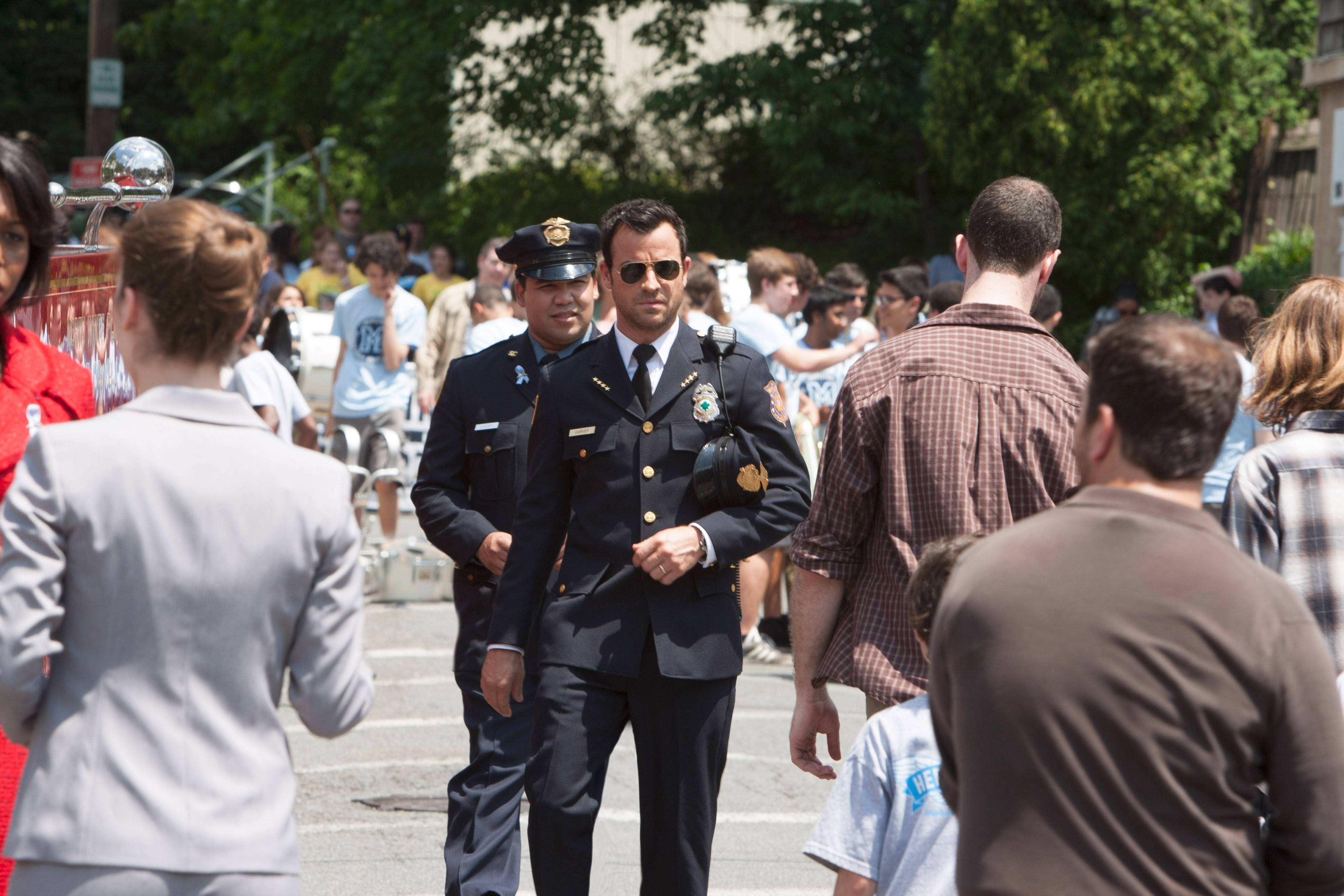 "Police chief Kevin Garvey (Justin Theroux), center, deals with fallout from the Sudden Departure — where 2 percent of the world's population disappeared — in HBO's ""The Leftovers."""