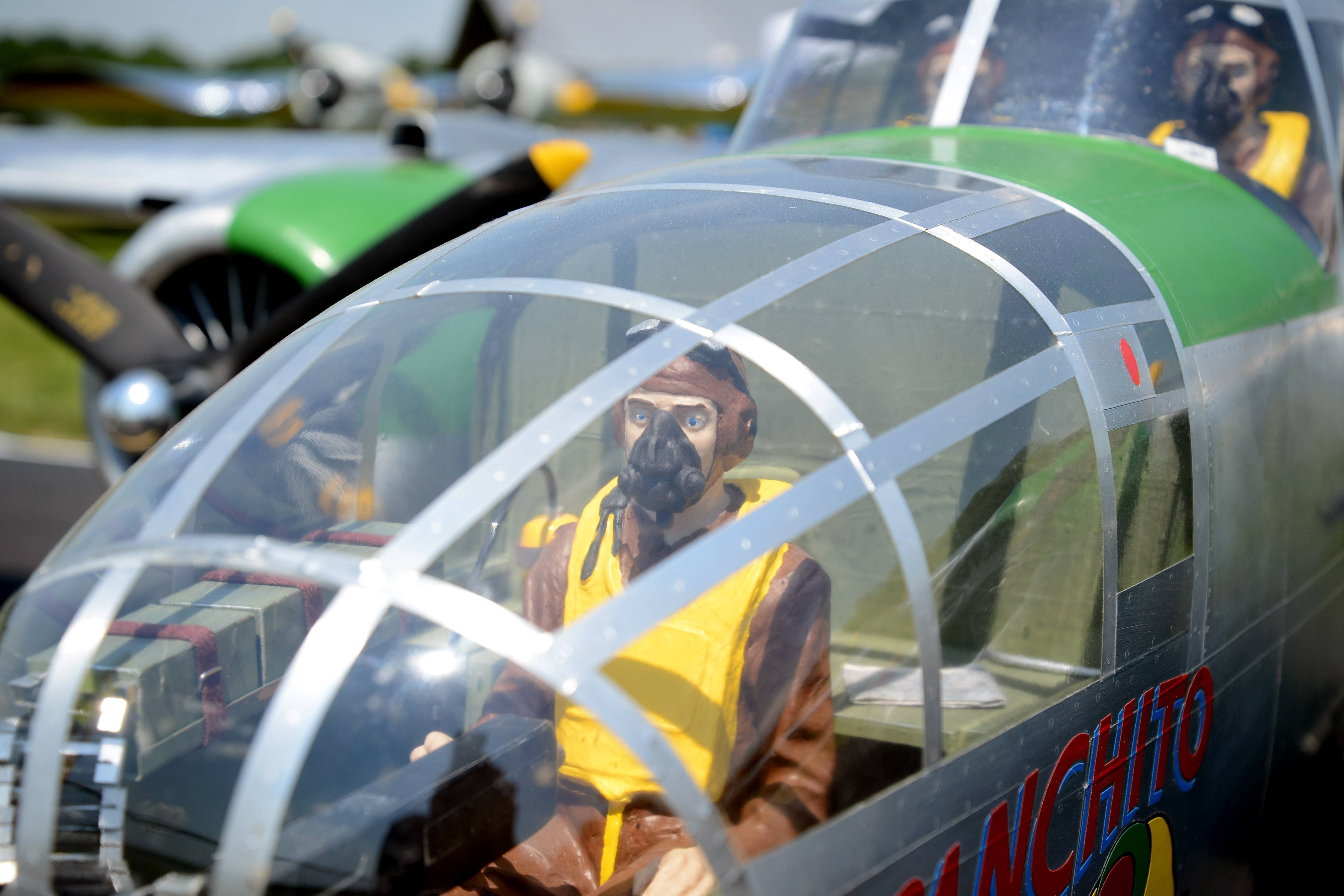 "Several doll pilots sit in various locations in a B-25 Mitchell 1/5 scale plane owned by Paul LeTourneau of Oconto, WI. It has a 162"" wing span, weighs 110 pounds and sports twin cylinder engines with 10HP each. LeTourneau built the plane from scratch 11 years ago and has been flying for about 20 years."