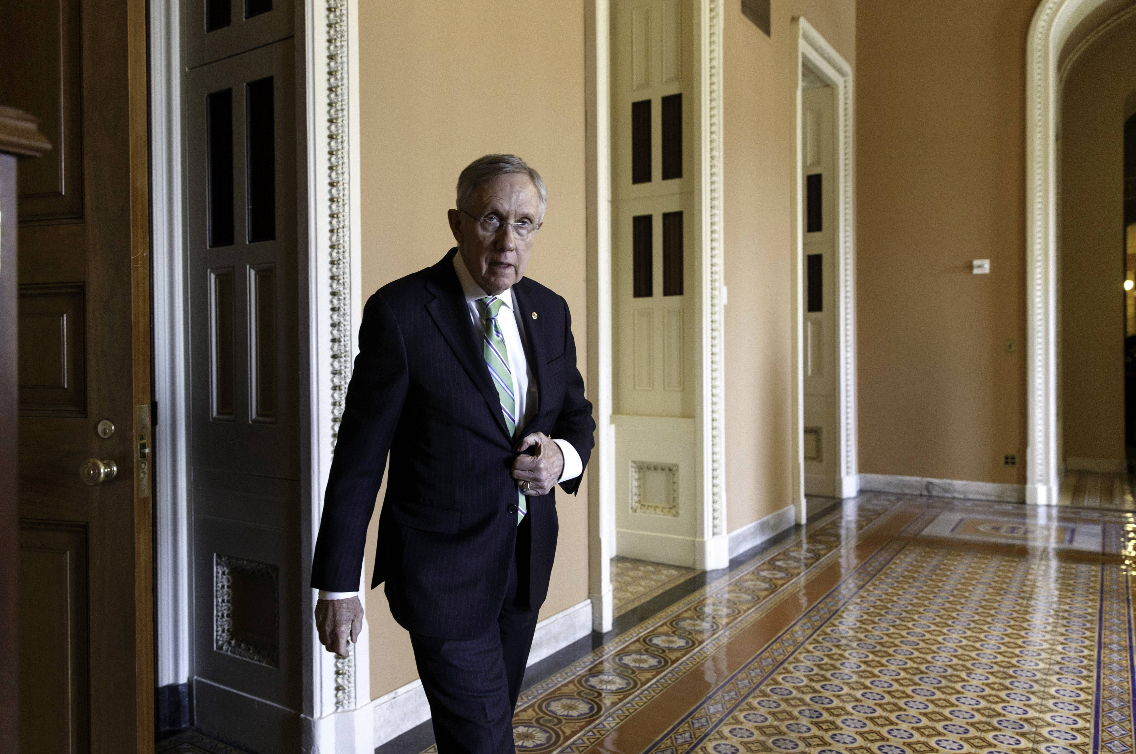 Senate Majority Leader Harry Reid of Nevada on his way to speak to reporters Tuesday on Capitol Hill in Washington.