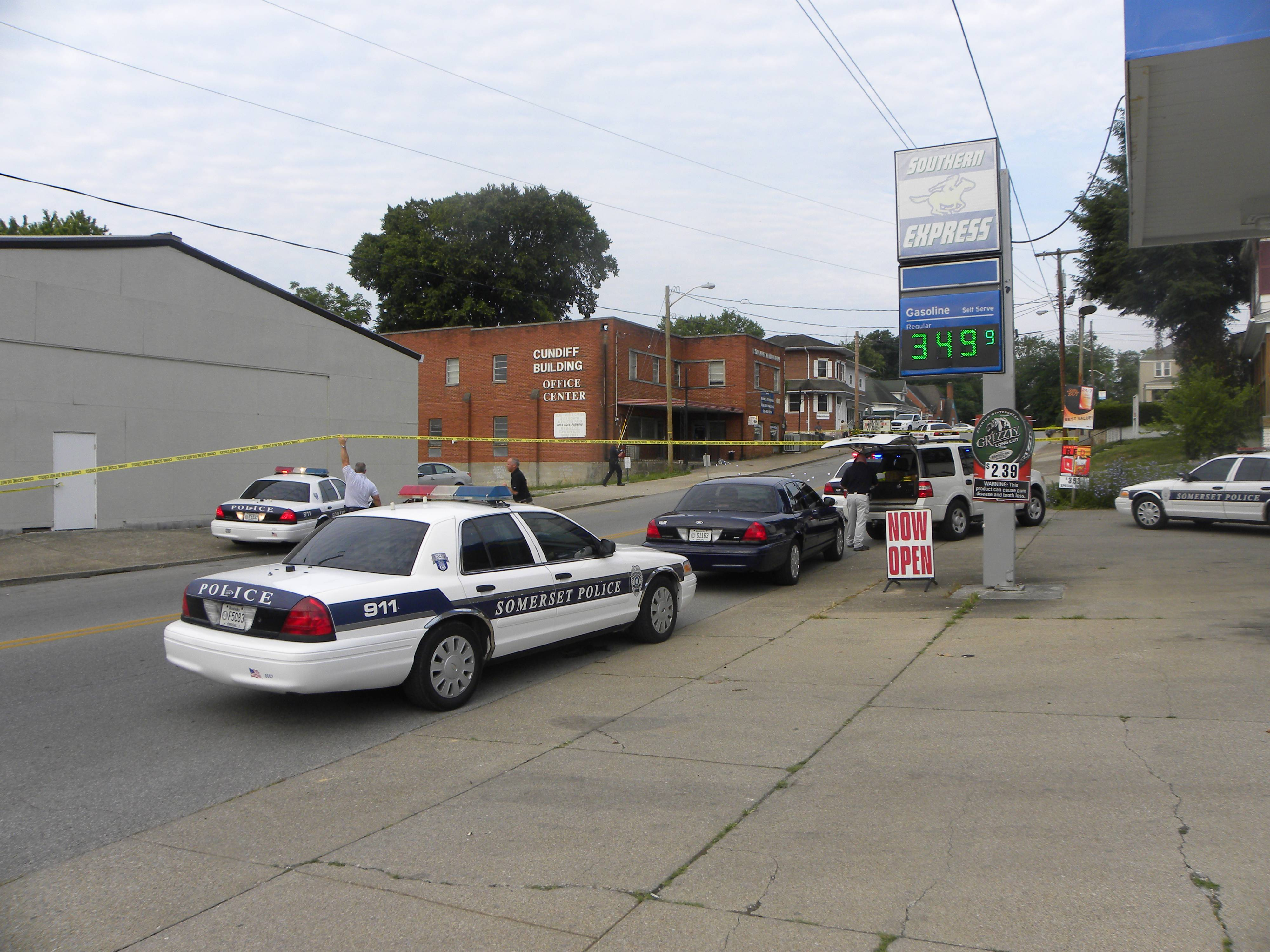 Somerset Police respond to the scene of a shooting Friday on West Mt. Vernon Street in Somerset, Kentucky. Somerset police say Mark Stanziano, 57, a defense attorney well known in his small, southern Kentucky town, was shot and killed outside of his law office.