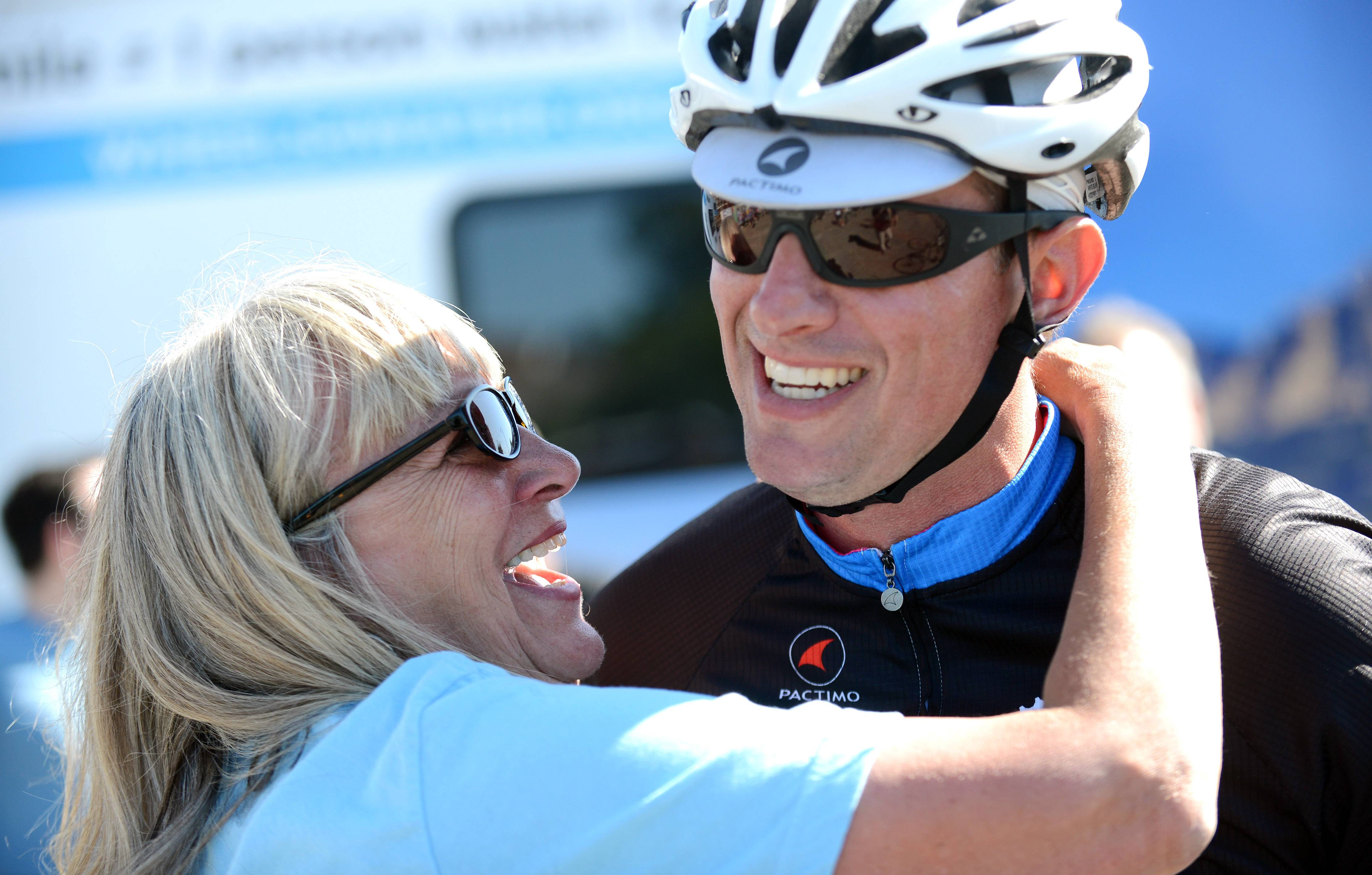 Justin Ahrens of Batavia gets a hug from his mom, Nancy Brenczski, of Joliet, after finishing the 15-day Wheels4Water bike ride earlier this month. The ride started in Boston and ended 1,207 miles later in Chicago. Ahrens and his team raised more than $93,000, which will provide water for life for more than 2,300 people in Lira, Uganda.
