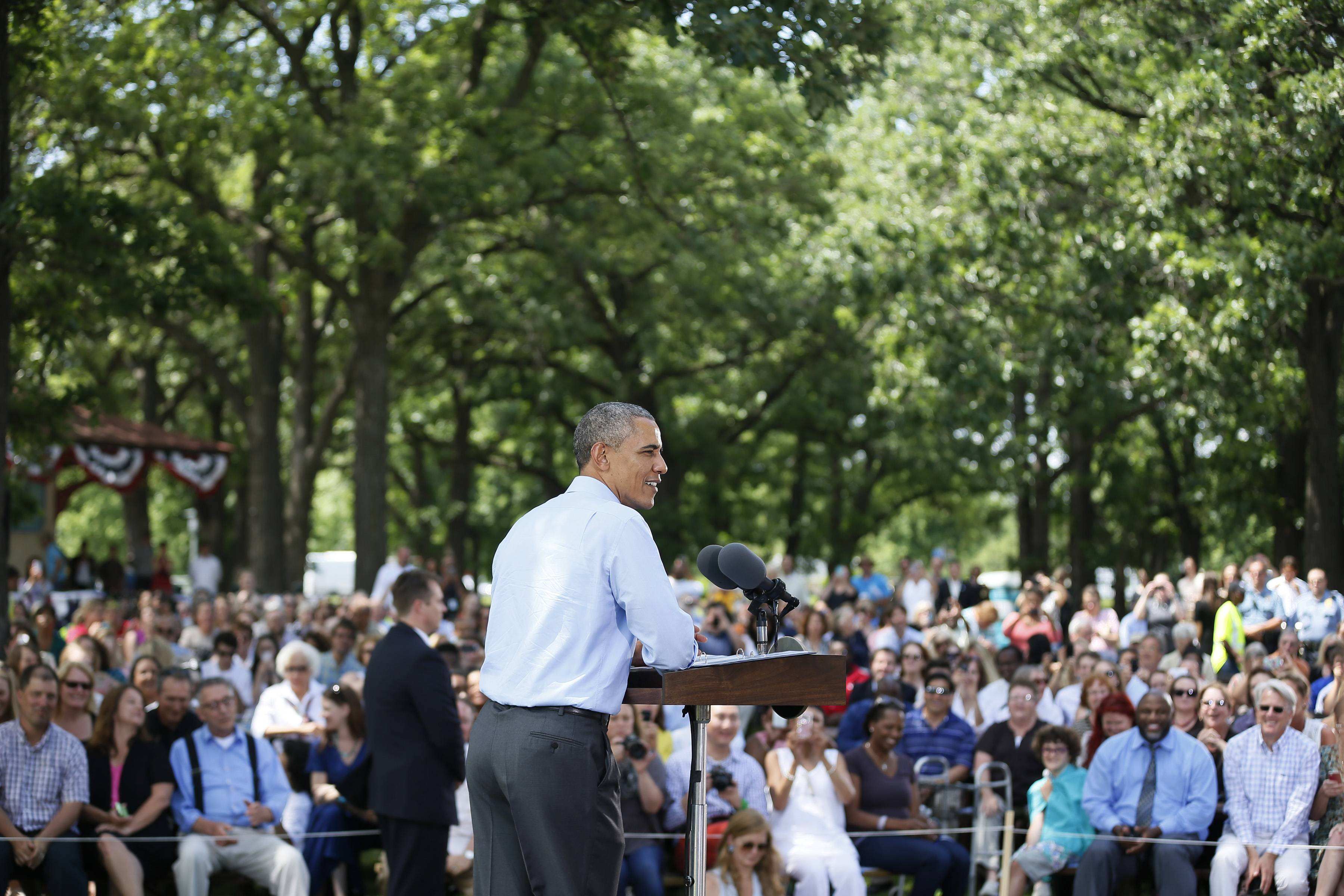 President Barack Obama speaks to an audience Thursday during a town hall meeting at Minnehaha Park in Minneapolis.