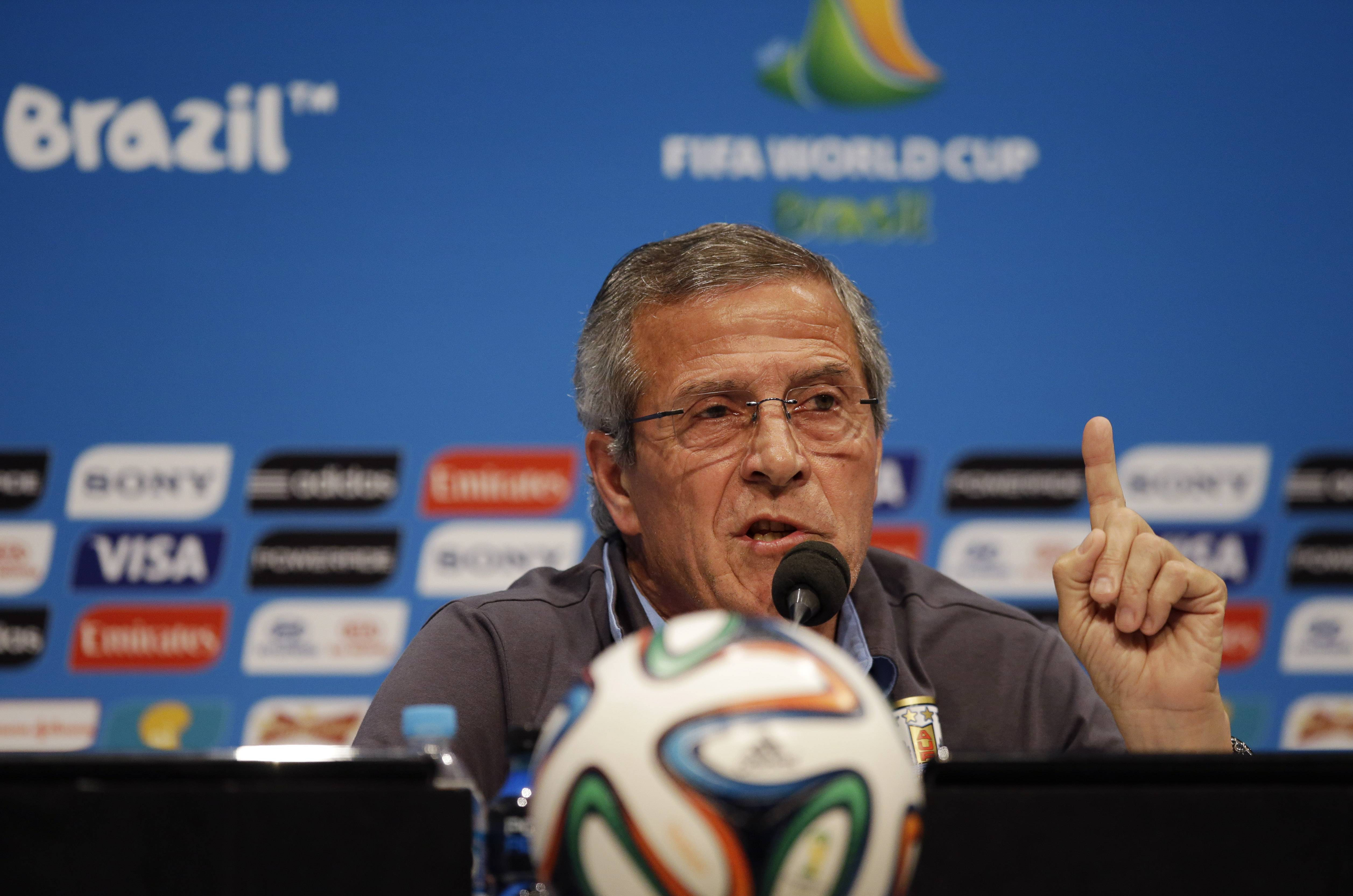Uruguay's head coach Oscar Tabarez makes a statement during a press conference the day before the round of 16 World Cup soccer match between Colombia and Uruguay at the Maracana Stadium in Rio de Janeiro, Brazil, Friday, June 27, 2014. FIFA banned Uruguay striker Luis Suarez from all football activities for four months on Thursday for biting an opponent at the World Cup, a punishment that rules him out of the rest of the tournament and the start of the upcoming Premier League season. (AP Photo/Matt Dunham)