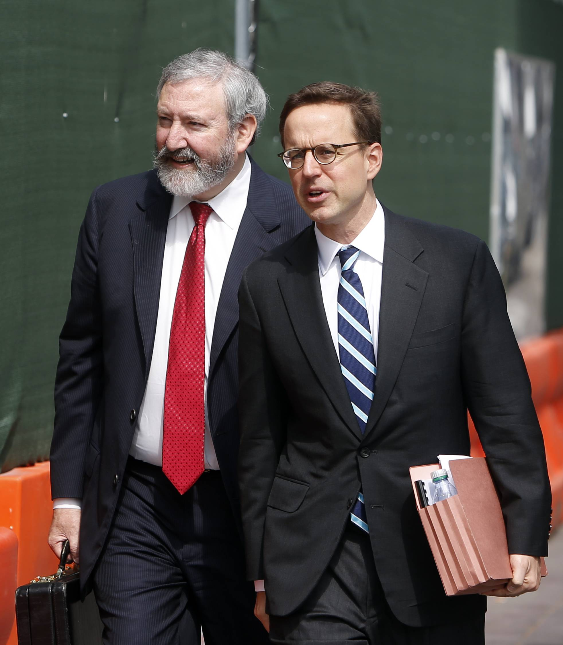 Jonathan Blackman, left, and Carmine Boccuzzi, lawyers representing Argentina, arrive at federal court in New York Friday for a hearing regarding the country's request to extend deadlines to repay a $1.65 billion debt to U.S. hedge funds.
