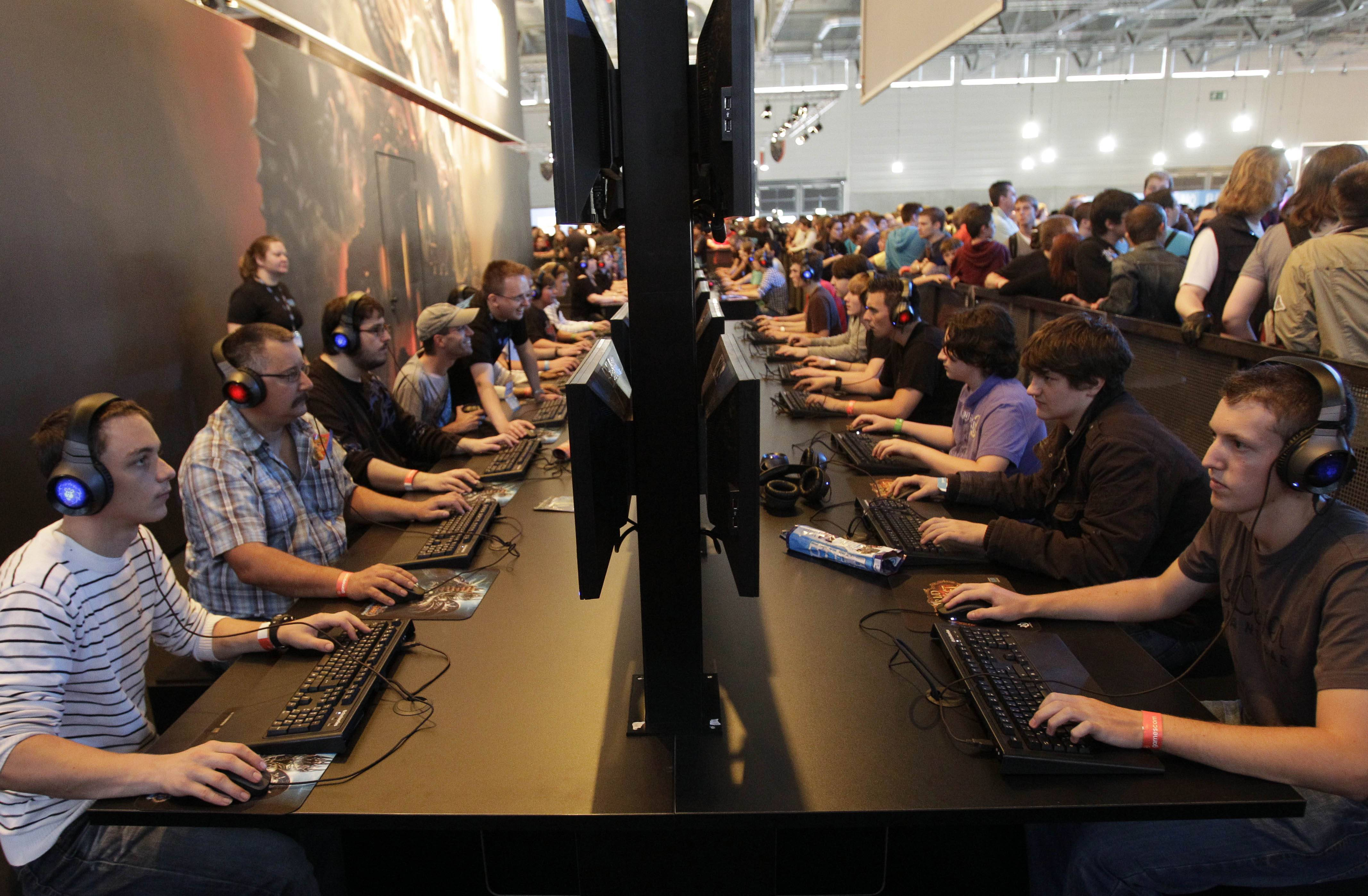 "In this Aug. 19, 2010 file photo, visitors play games on a computer keyboard during the international gamescom fair in Cologne, western Germany. Frustration over passwords is as common across the age brackets. Bill Lidinsky, director of security and forensics at the School of Applied Technology at the Illinois Institute of Technology, recommends using a ""simple mental algorithm,"" including those that use a space, if a site allows that."