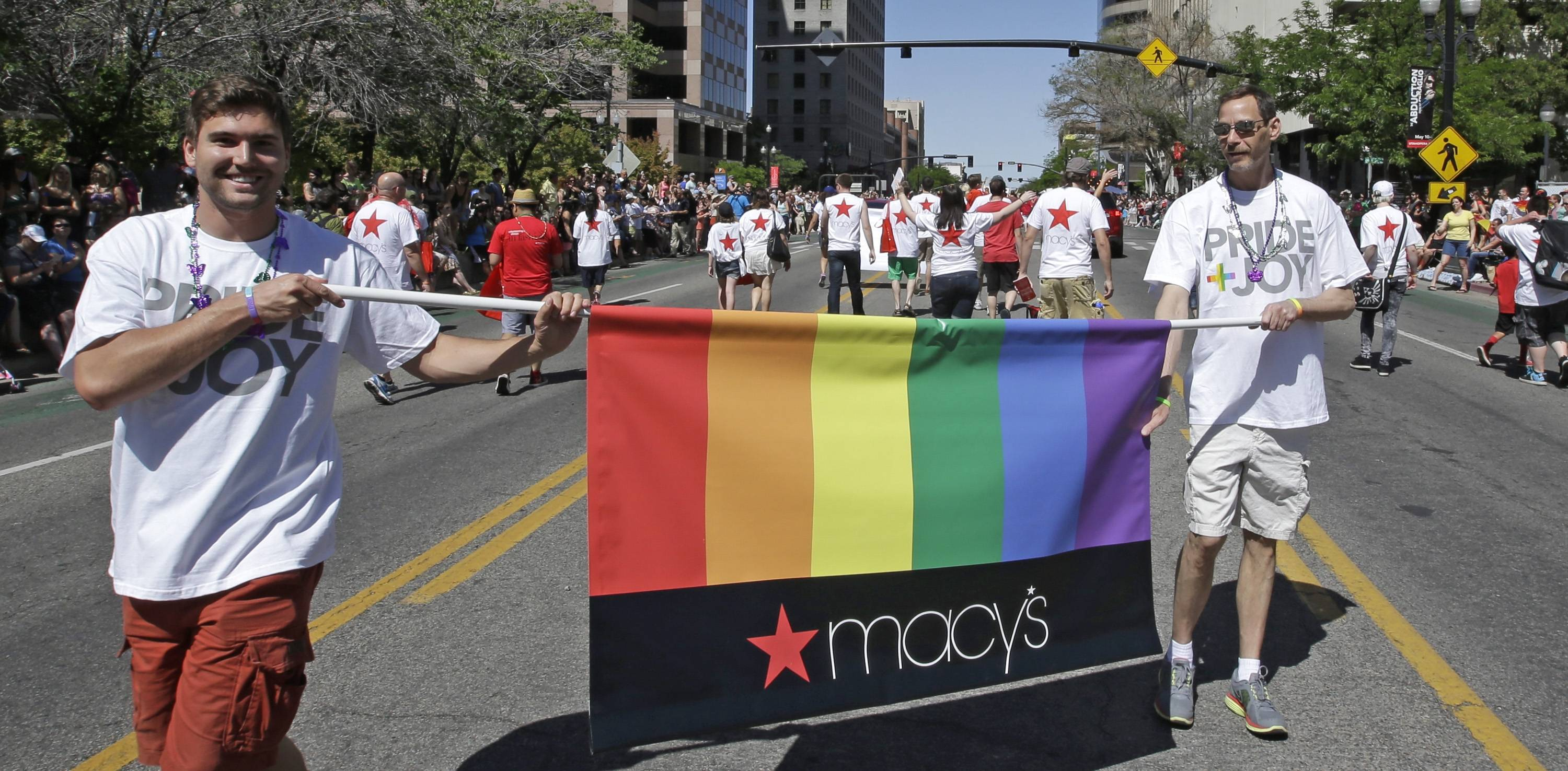 Workers carry a Macy's banner during the gay pride parade in Salt Lake City. Corporations have increased visibility this summer at gay pride parades around the country as same-sex marriage bans fall in the courts and polls show greater public acceptance of gay marriage.