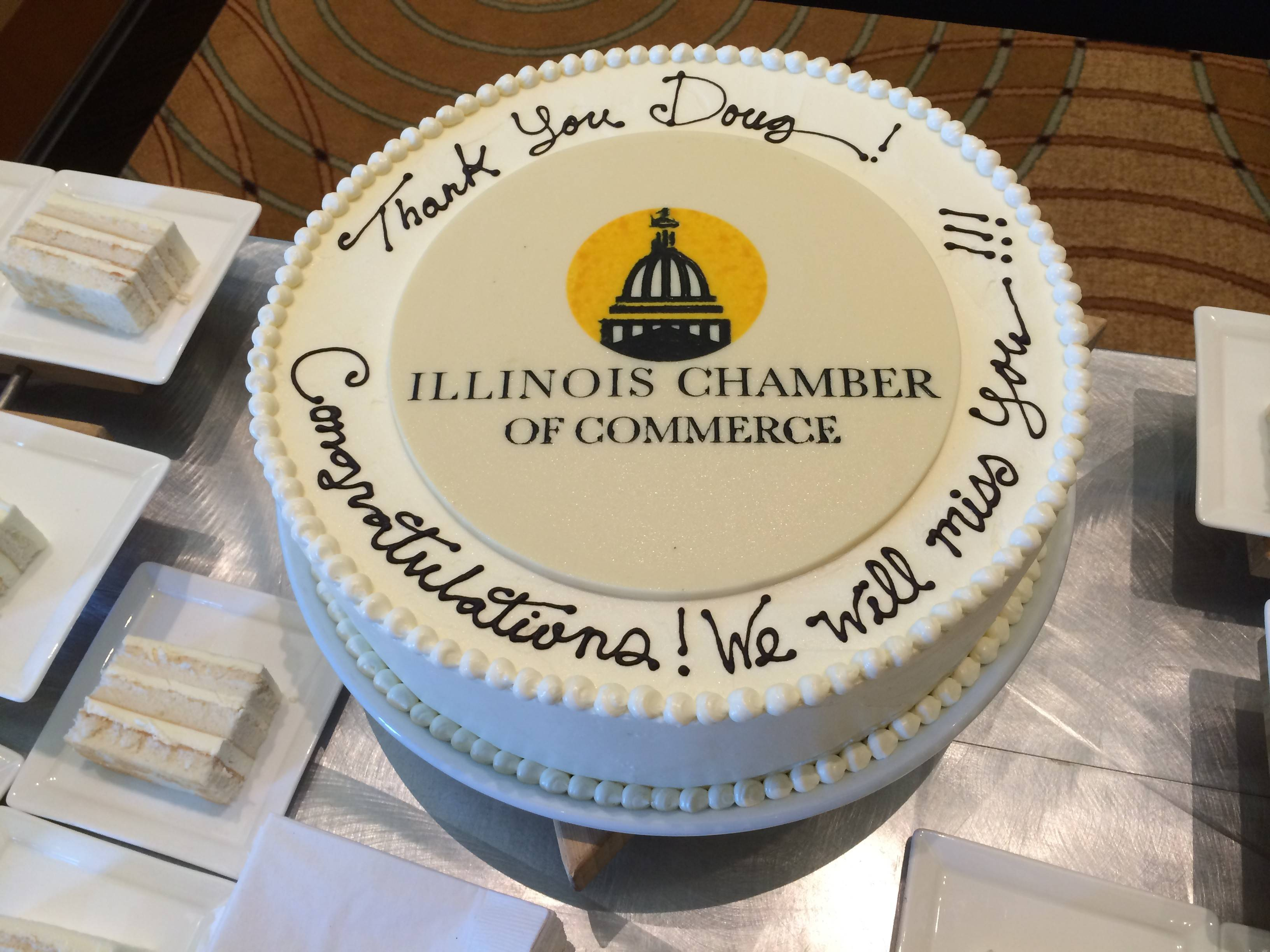 Illinois Chamber of Chamber's outgoing CEO Doug Whitley said a fond farewell to staff and members Thursday during the group's annual meeting. Cake was waiting for him in the lobby.