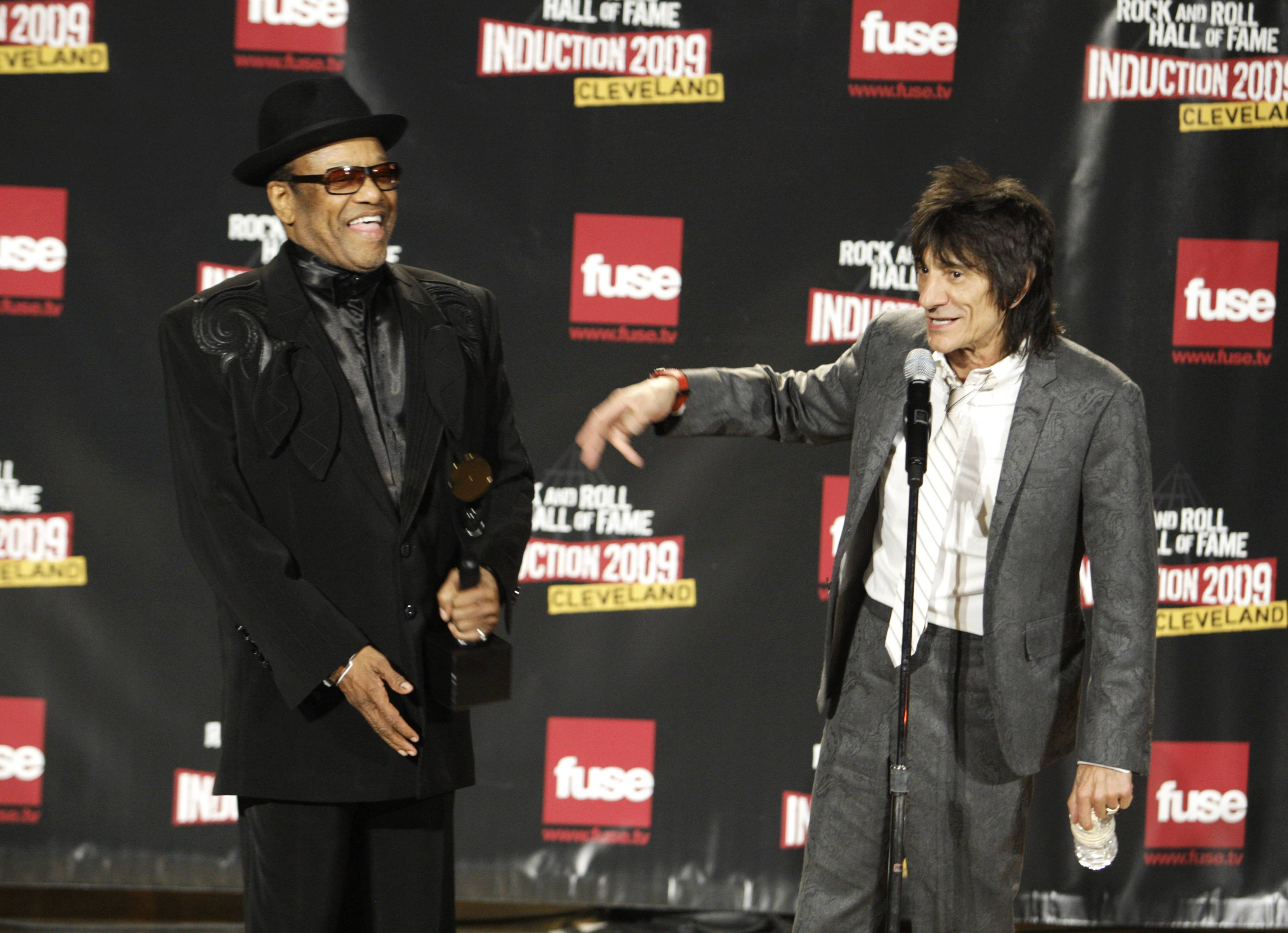Bobby Womack, left, and Ronnie Wood of the Rolling Stones speak backstage after Womack was inducted into the Rock and Roll Hall of Fame at the 2009 induction ceremony in Cleveland. Womack, 70, a colorful and highly influential R&B singer-songwriter who impacted artists from the Rolling Stones to Damon Albarn, has died. Womack's publicist Sonya Kolowrat confirmed to The Associated Press on Friday, June 27, 2014, that the singer died but had no other details to provide.