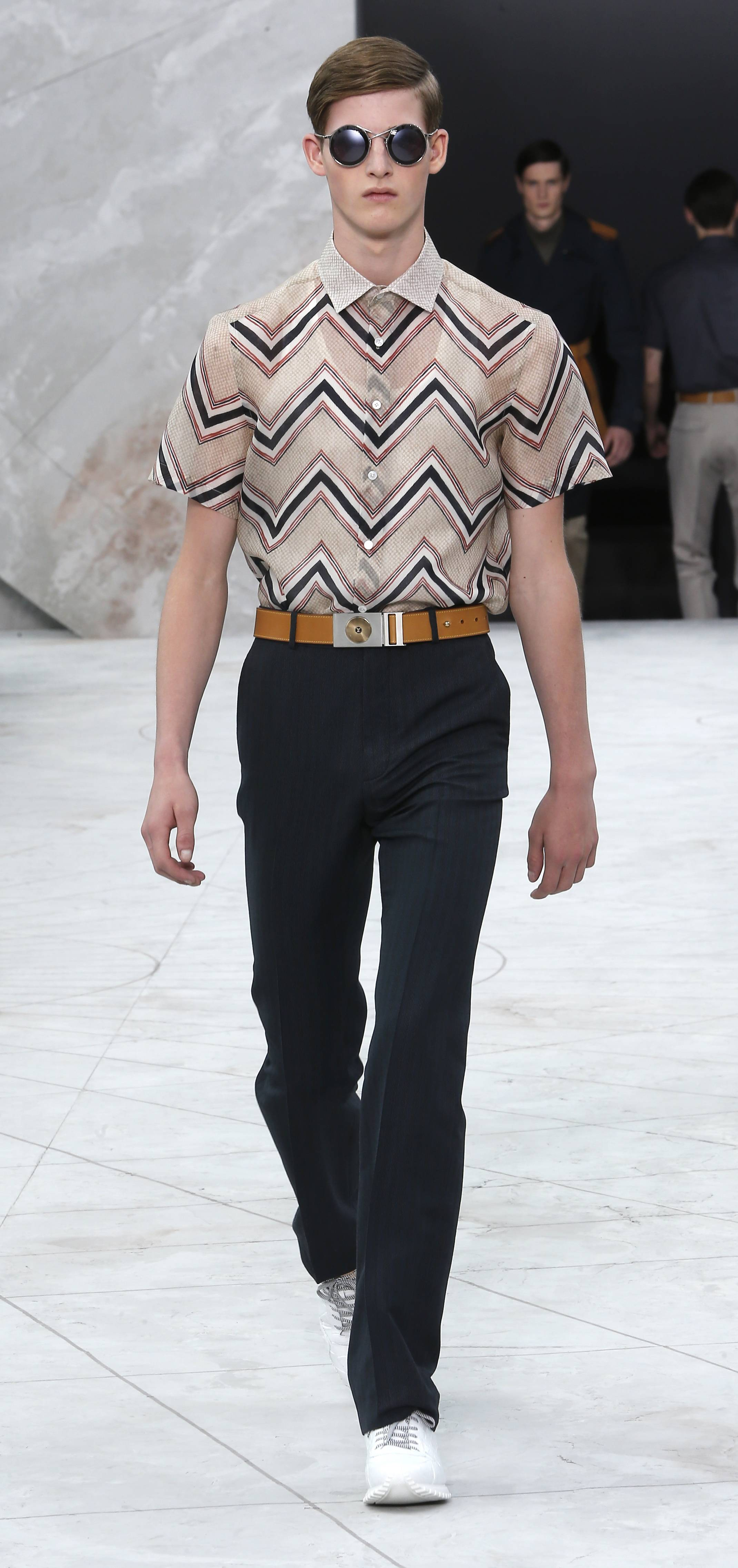 A model wears a creation for Louis Vuitton men's spring-summer 2015 fashion collection presented in Paris Thursday.