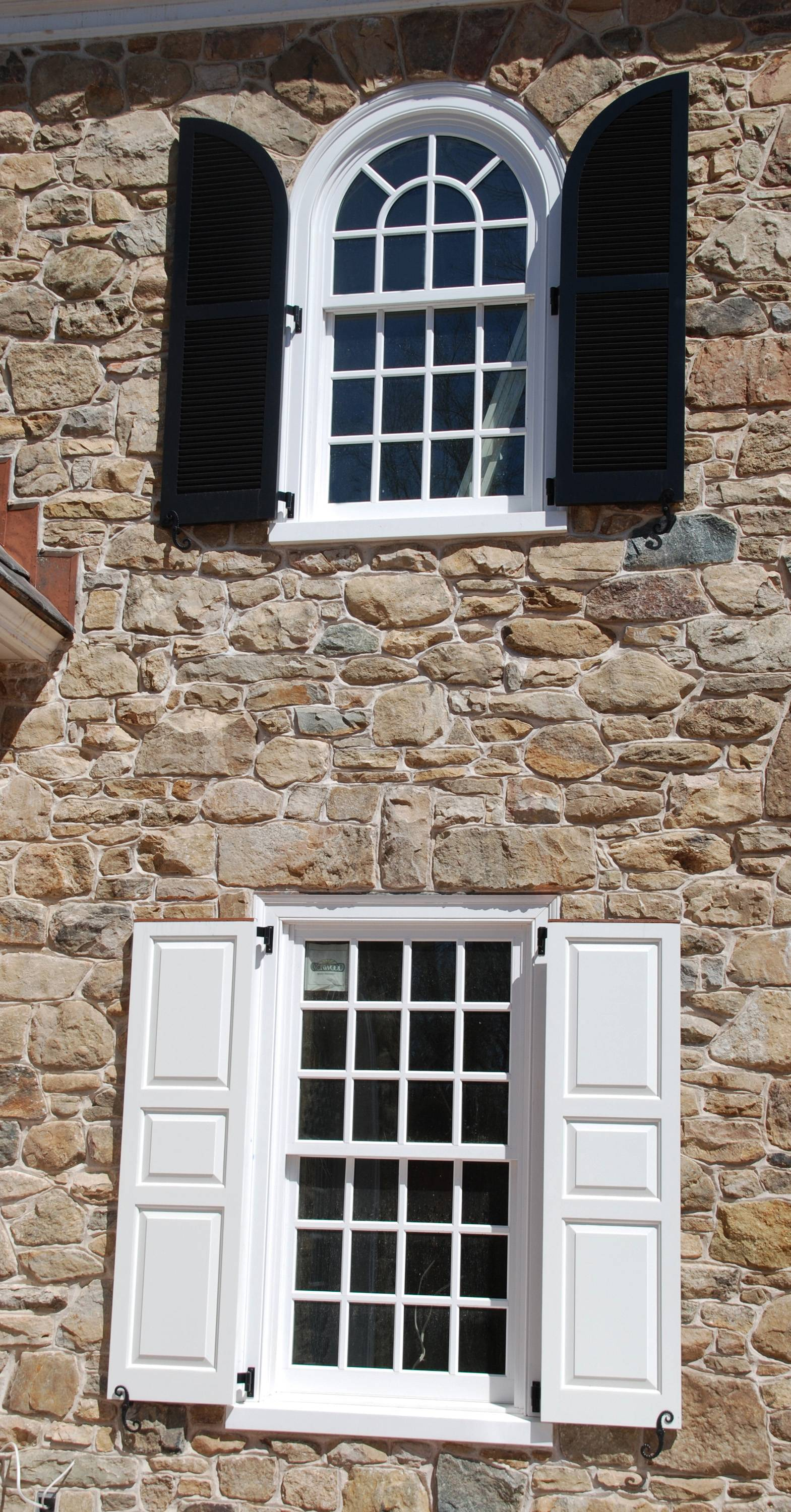 Homeowners often choose the wrong shape of shutters for arched windows. The shutters must be the right shape and size so that they will meet in the middle of the window and completely cover the opening.