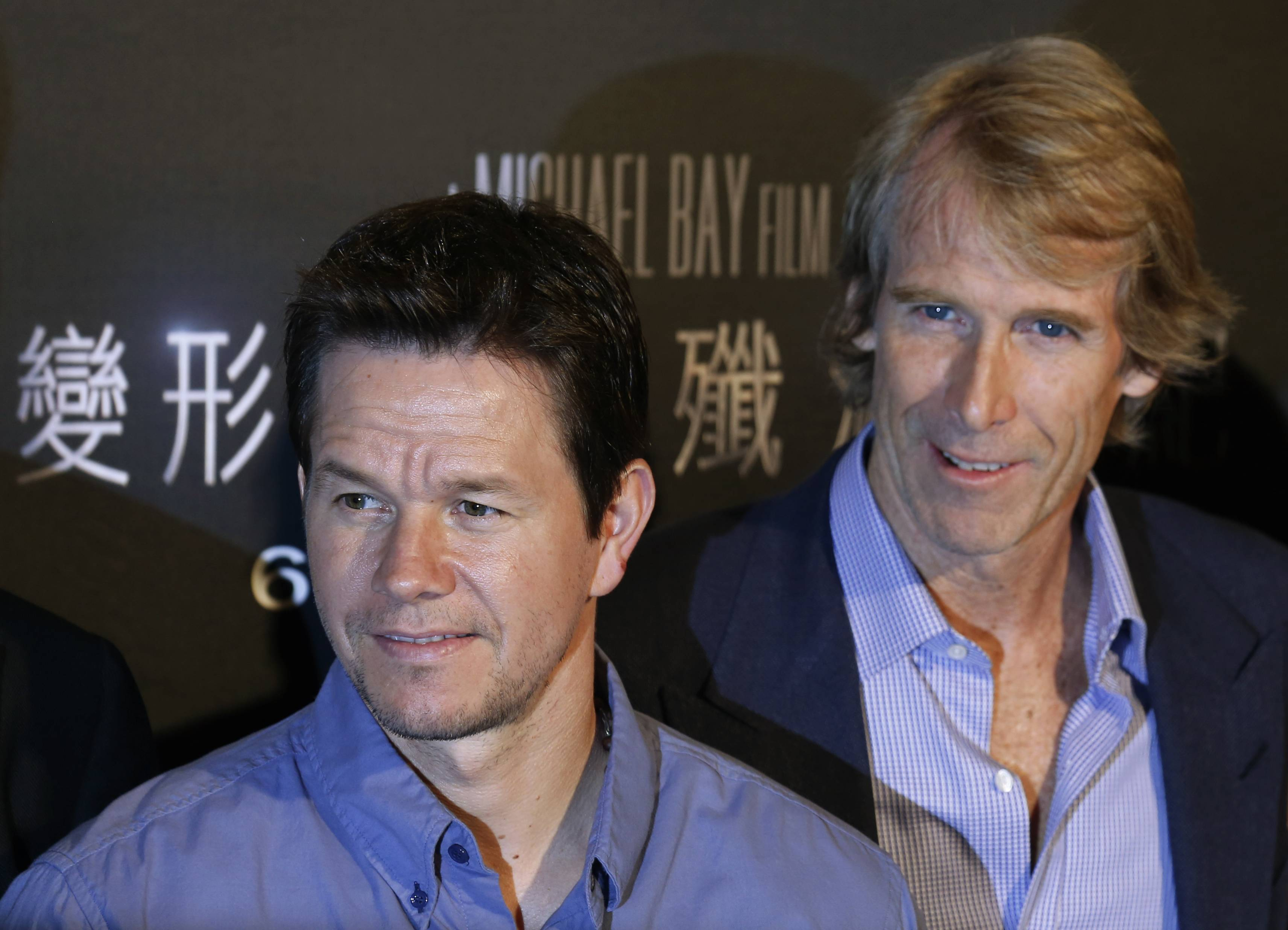 "Director Michael Bay, right, and actor Mark Wahlberg pose before a news conference on their movie ""Transformers 4: Age of Extinction"" in Hong Kong last week."
