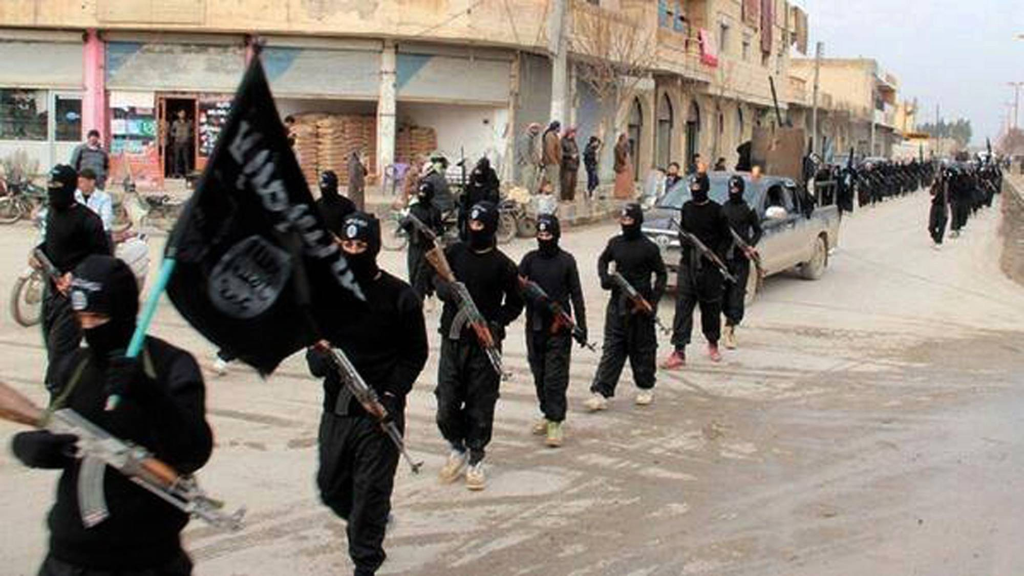 Fighters from the al-Qaida linked Islamic State of Iraq and the Levant (ISIL) march in Raqqa, Syria.