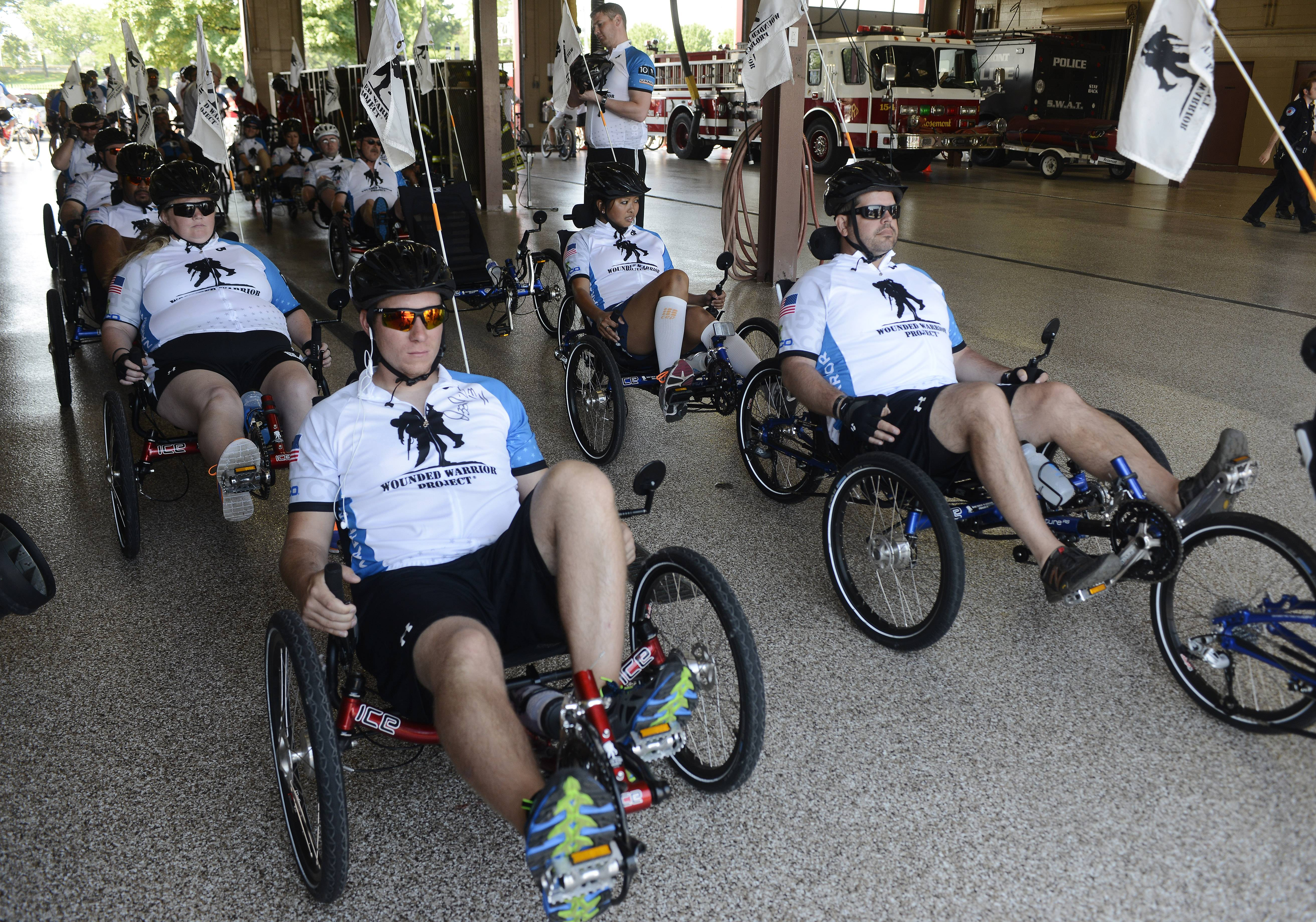 Jason Foster, left, of Colorado Springs, is among the riders participating this weekend in a series of cycling events sponsored by the Wounded Warrior Project. The group rode Friday from the Rosemont fire station on River Road, going 17 miles and ending at The Ballpark at Rosemont.