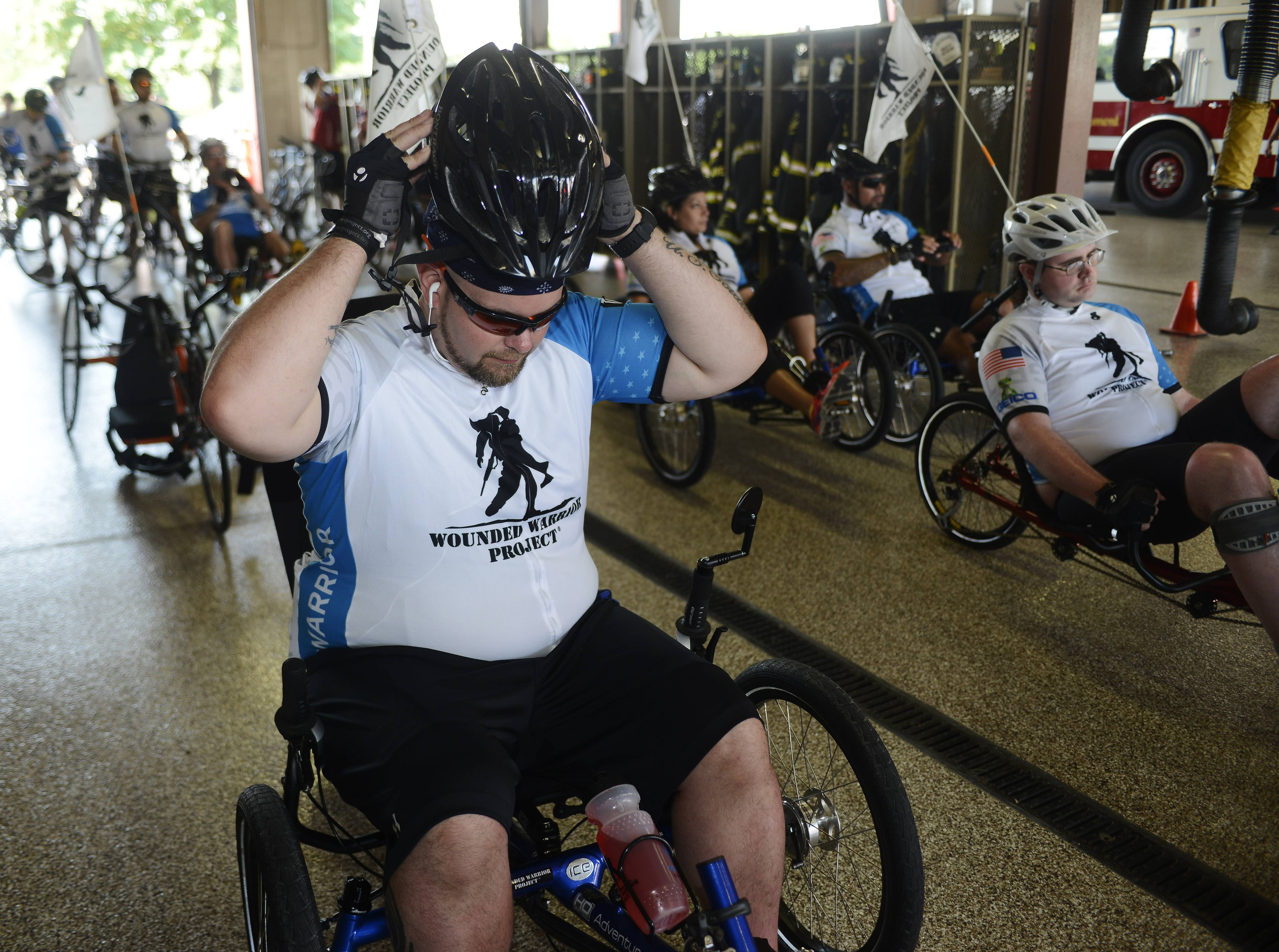 David Buckner of Rockford puts on his helmet prior to the start of the Wounded Warrior Project's Soldier Ride Friday at the Rosemont fire station on River Road.