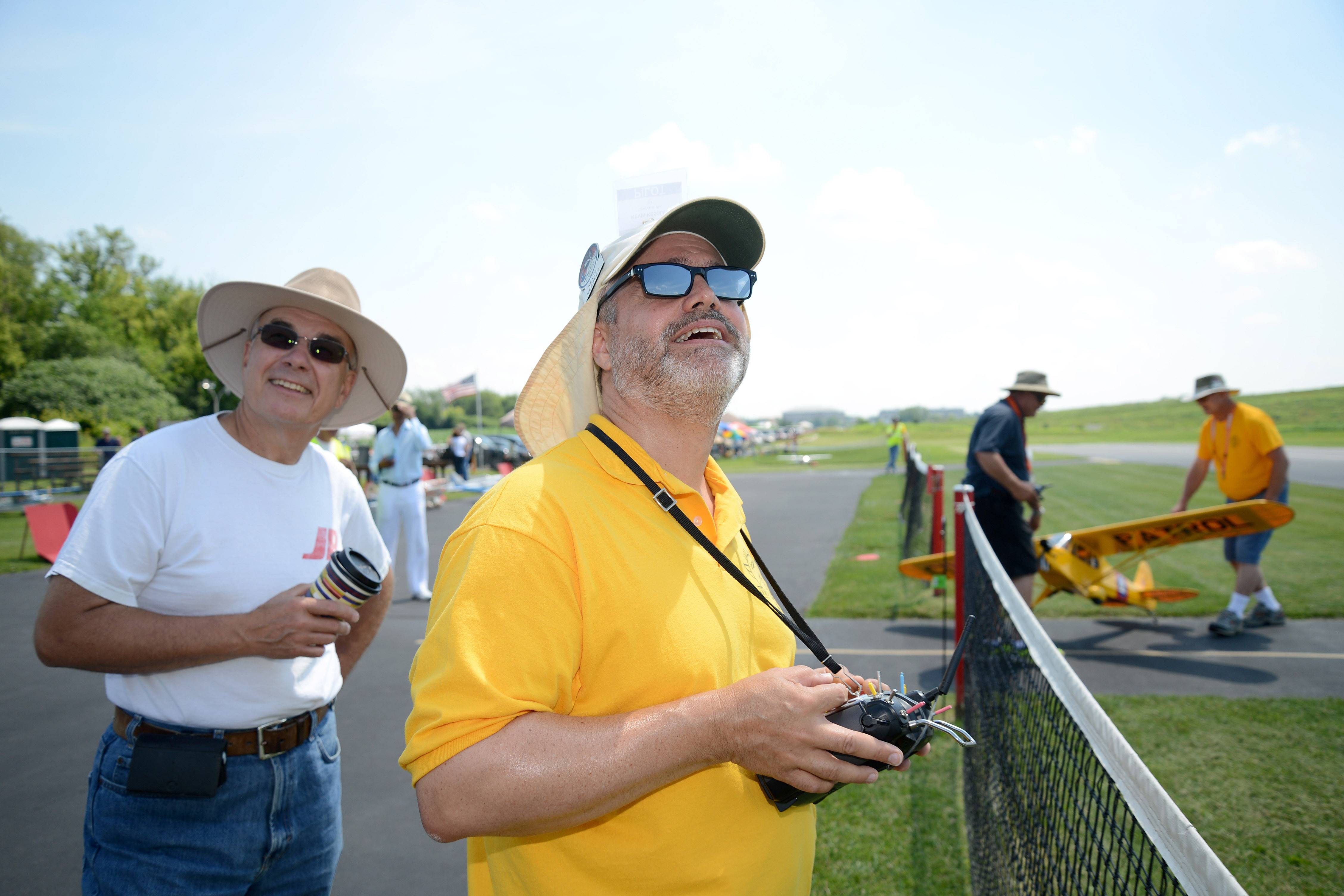 Kevin Kessler of Geneva flies his Piper Super Cub one-quarter scale plane as Rich Gabrys of Elgin acts as his spotter at the Fox Valley Aero Club's Windy City Warbird and Classics model airplane show Friday in St. Charles. Kessler owns about 15 planes has been a member of the club for five years.