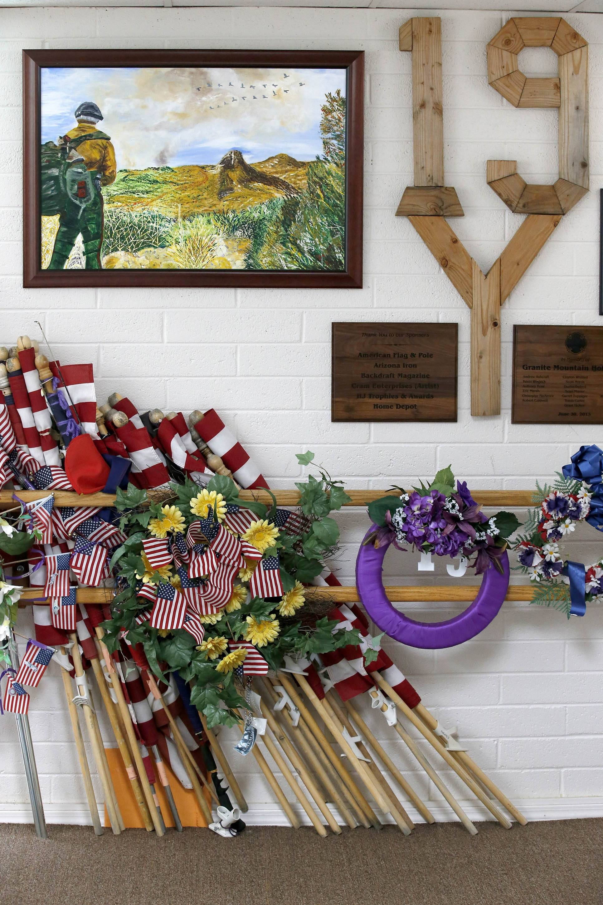 Just some of the thousands of artifacts saved for the Tribute Fence Preservation Project honoring the 19 Granite Mountain Hotshots who were killed nearly a year ago fighting an Arizona wildfire on Tuesday, June 24, 2014, in Prescott, Ariz.