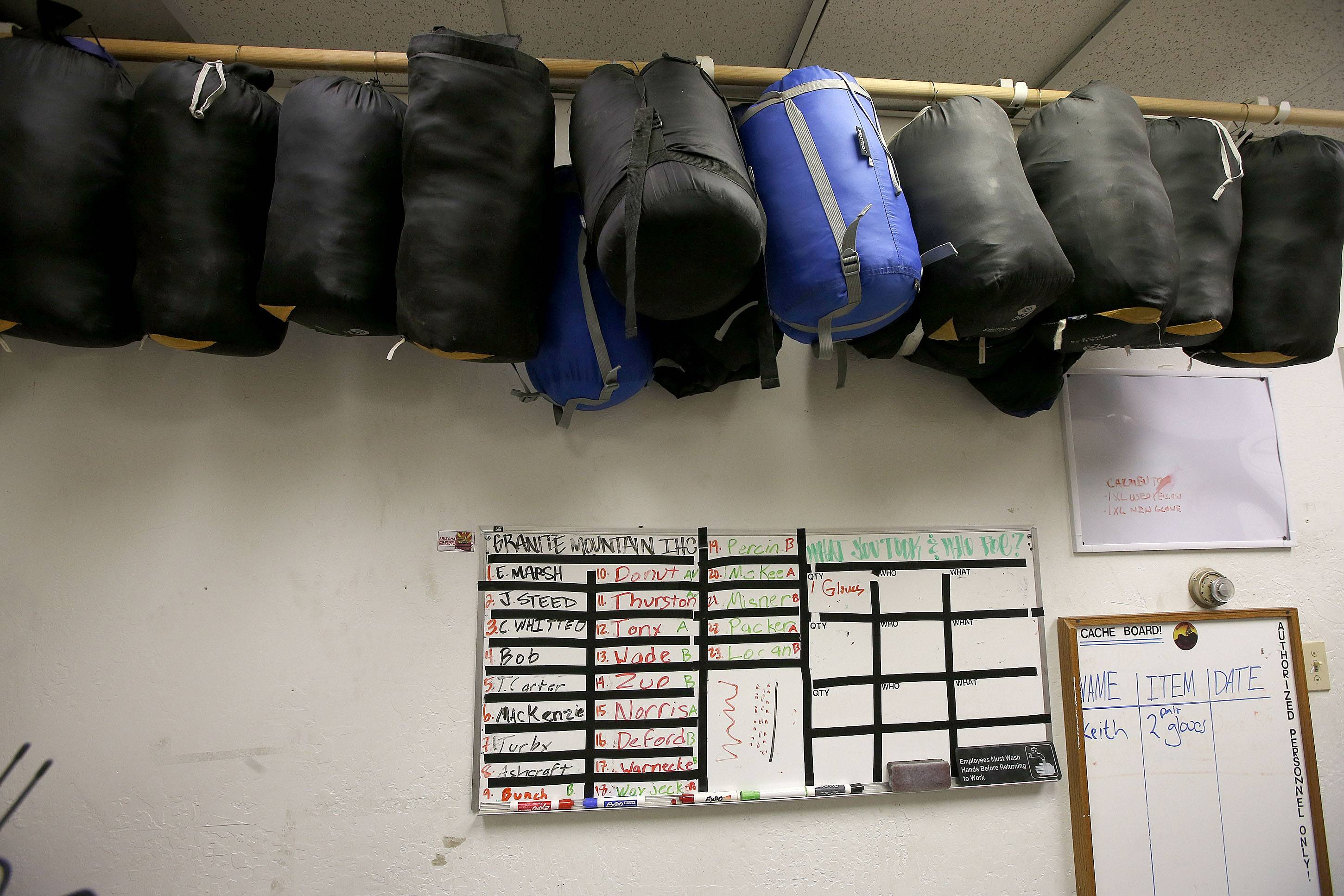 Inside the Granite Mountain Hotshots firehouse the assignment board has been left as it was a year ago, when 19 hotshots were killed fighting a wildfire, on Tuesday, June 24, 2014, in Prescott, Ariz.