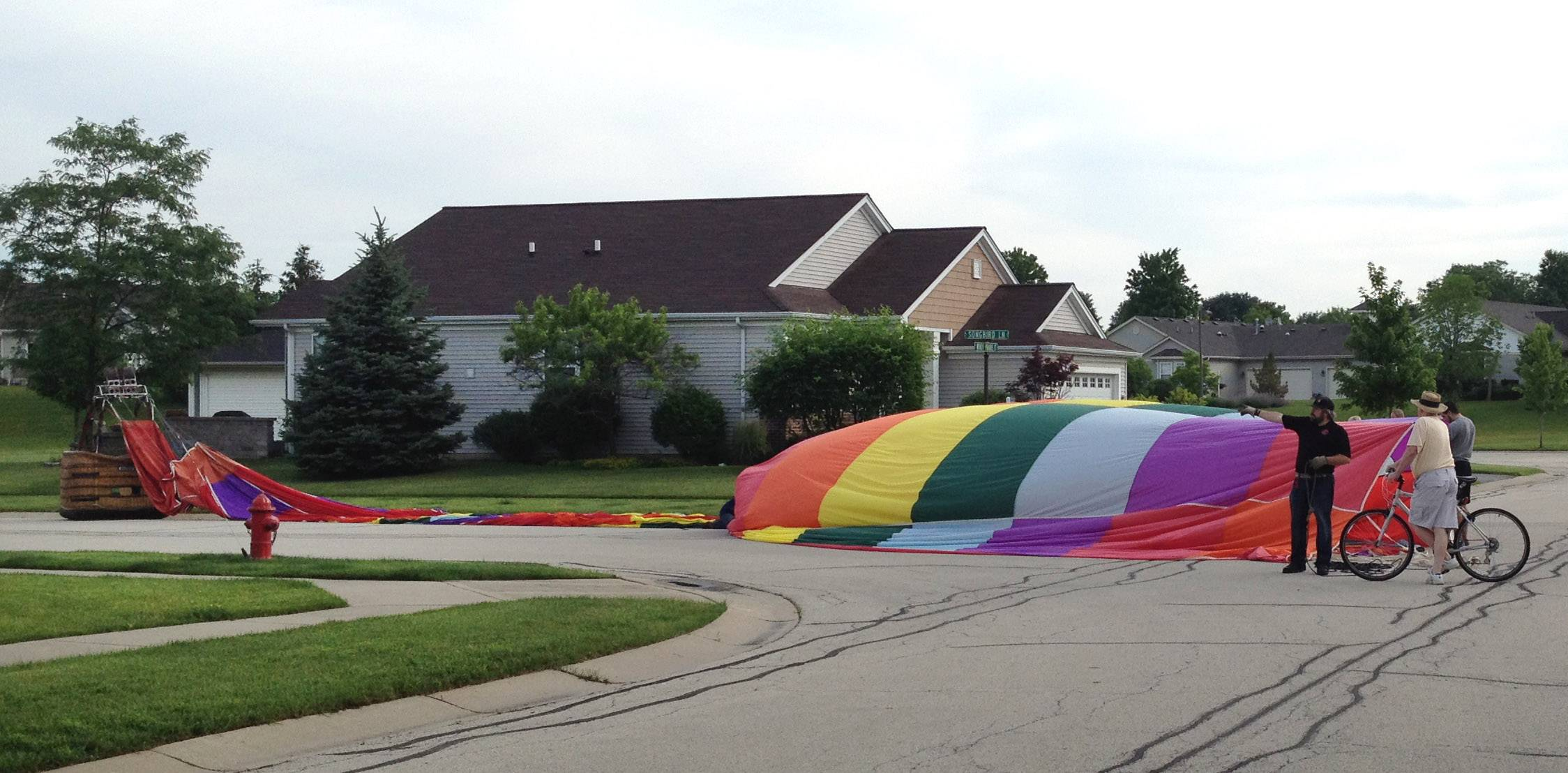 Flight regulators say the hot-air balloon that made an emergency landing in the middle of an intersection in Huntley's Sun City neighborhood early Tuesday did not violate FAA flight rules.